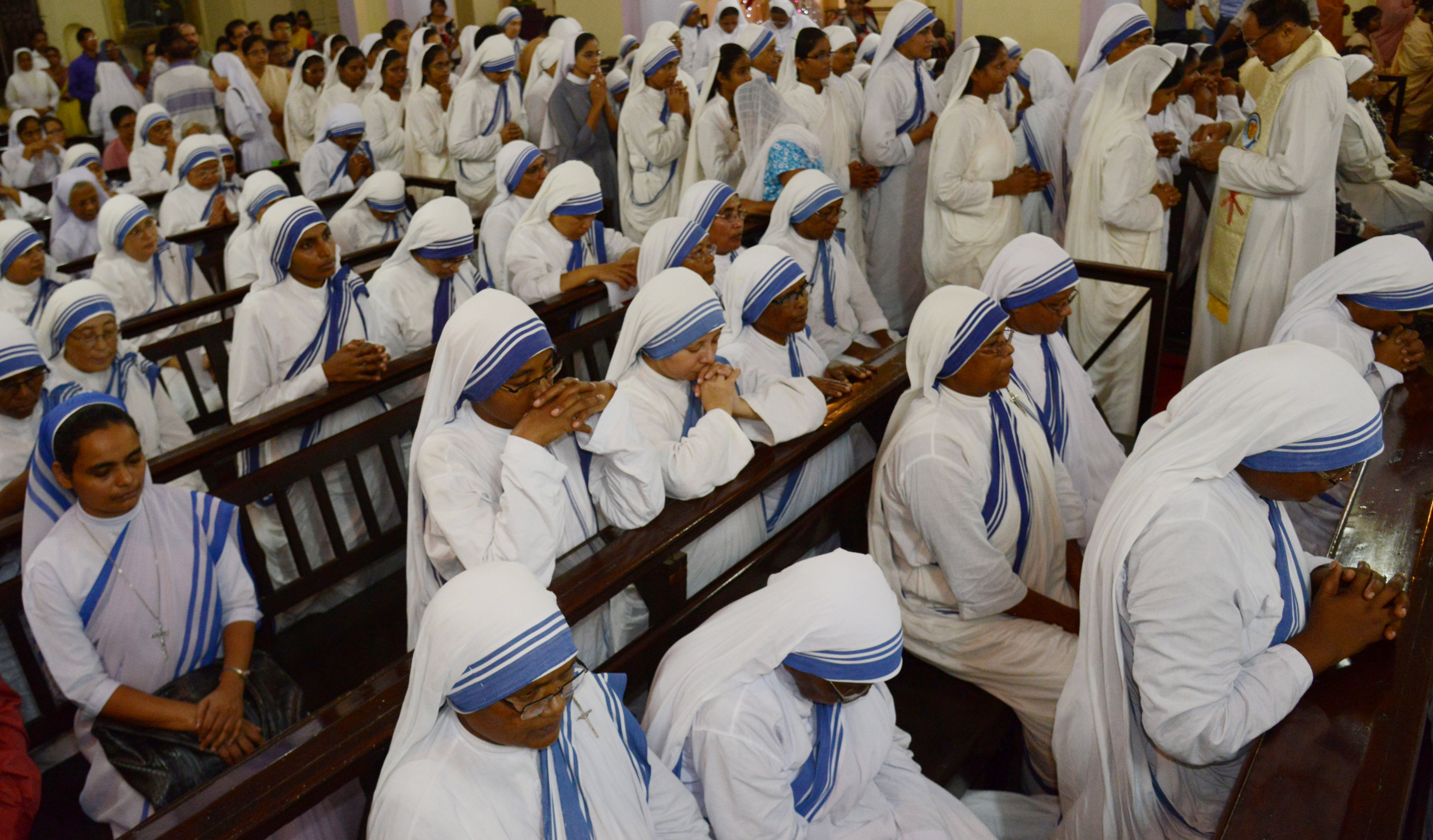 Indian Roman Catholic nuns of the Missionaries of Charity order attend a mass to announce St. Teresa of Calcutta a 'co-patron' of the archdiocese at the Cathedral of the Most Holy Rosary in Kolkata on September 6, 2017. (DIBYANGSHU SARKAR/AFP/Getty Images)