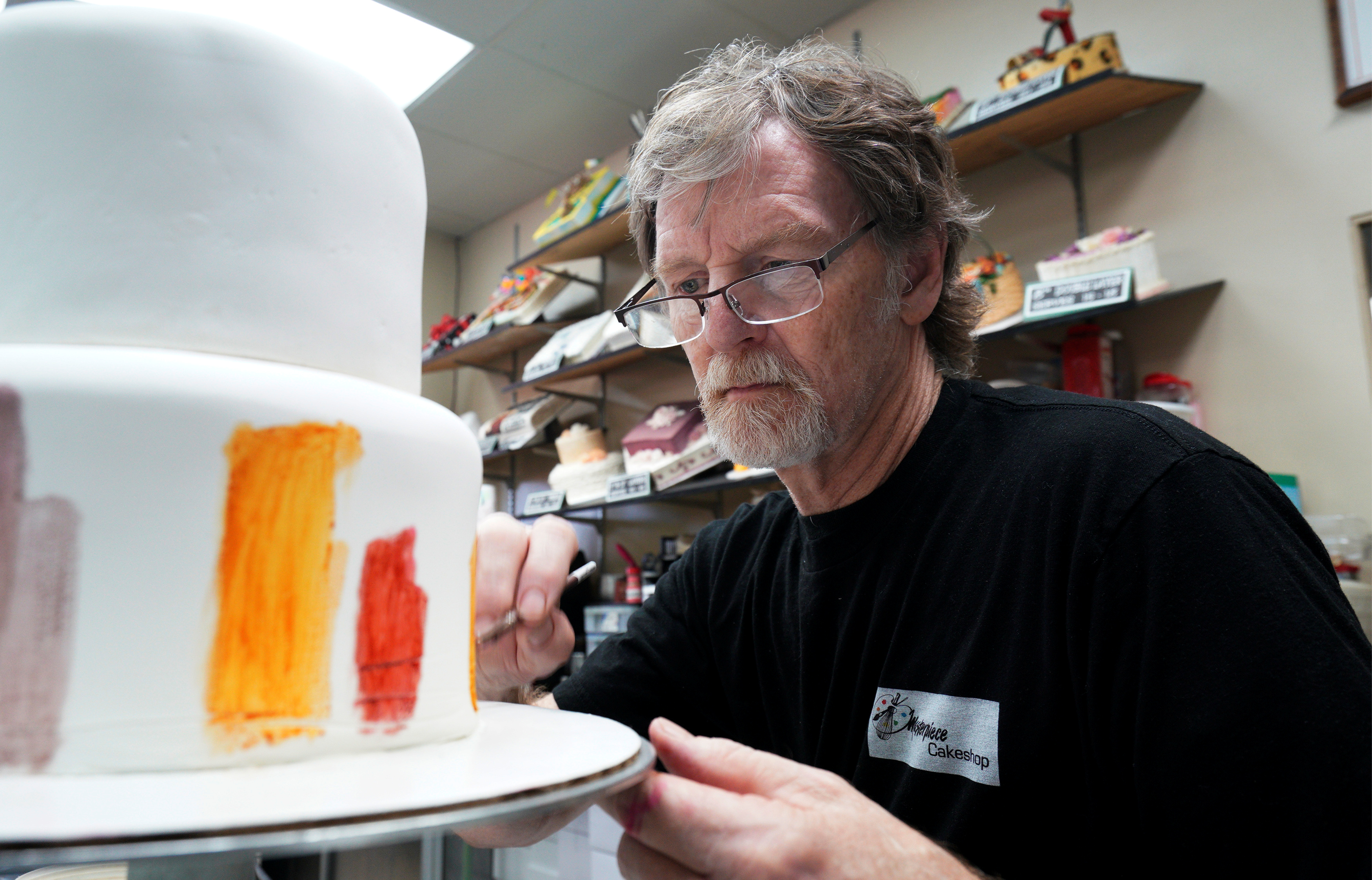 Baker Jack Phillips decorates a cake in his Masterpiece Cakeshop in Lakewood, Colorado September 21, 2017. REUTERS/Rick Wilking