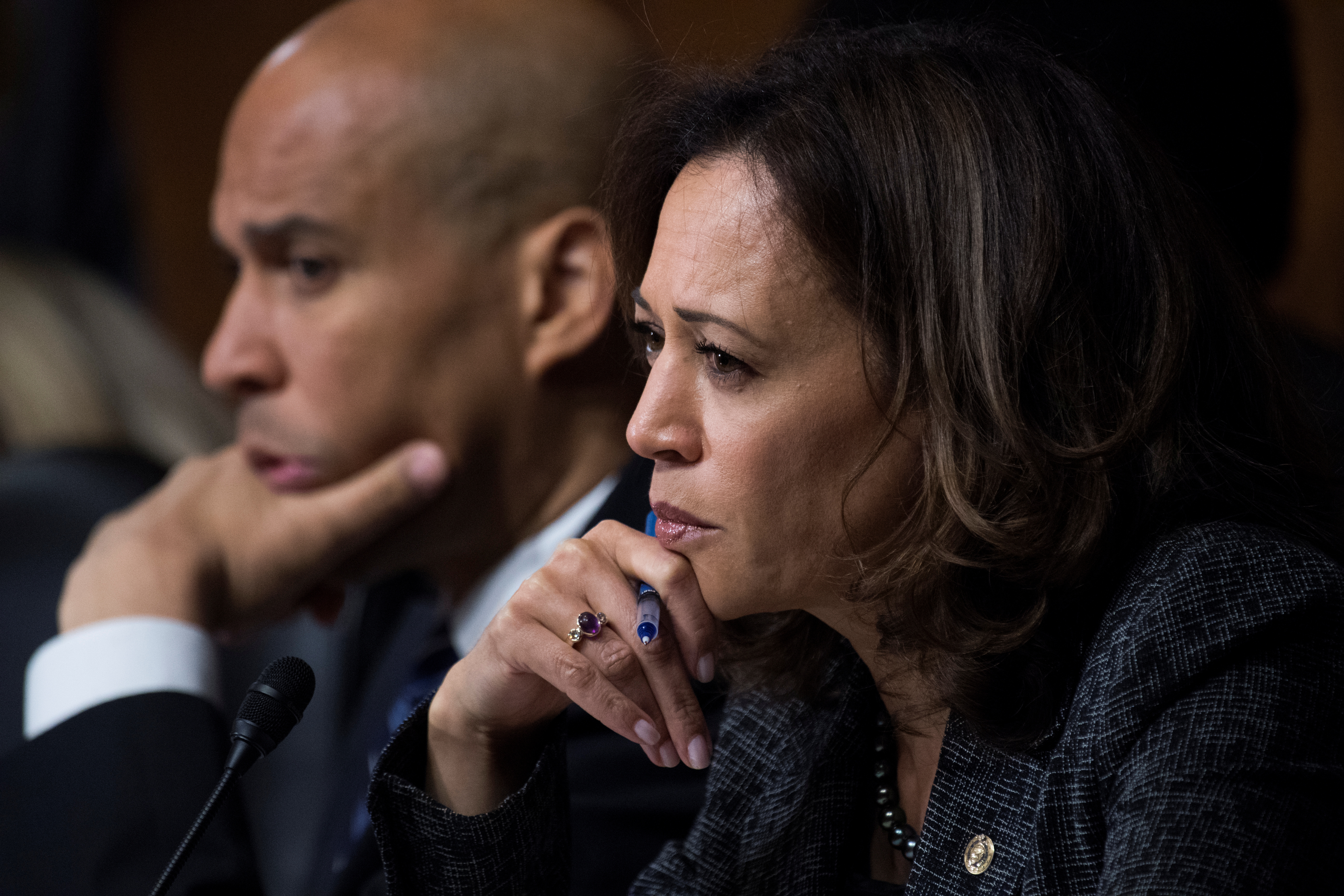 Sen. Cory Booker, D-N.J., and Sen. Kamala Harris, D-Calif., listen as Dr. Christine Blasey Ford testifies during the Senate Judiciary Committee hearing on the nomination of Brett M. Kavanaugh to be an associate justice of the Supreme Court of the United States, focusing on allegations of sexual assault by Kavanaugh against Christine Blasey Ford in the early 1980s, in Washington, DC, U.S., September 27, 2018. Tom Williams/Pool via REUTERS