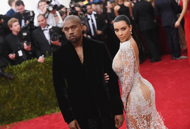 "Kanye West (L) and Kim Kardashian attend the ""China: Through The Looking Glass"" Costume Institute Benefit Gala at the Metropolitan Museum of Art on May 4, 2015 in New York City. (Photo by Mike Coppola/Getty Images)"