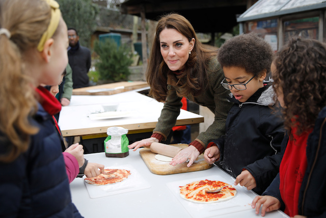 Britain's Catherine, Duchess of Cambridge helps make pizza as she visits the King Henry's Walk Garden in Islington, London, Britain January 15, 2019. Tolga Akmen/Pool via REUTERS