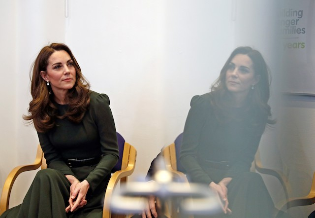 Catherine, Duchess of Cambridge watches a video presentation while reflected in a watches a video presentation while reflected in a glass door during a visit to a new national support line at the charity, Family Action on January 22, 2019 in Lewisham, England. (Photo by Adrian Dennis - WPA Pool/Getty Images)