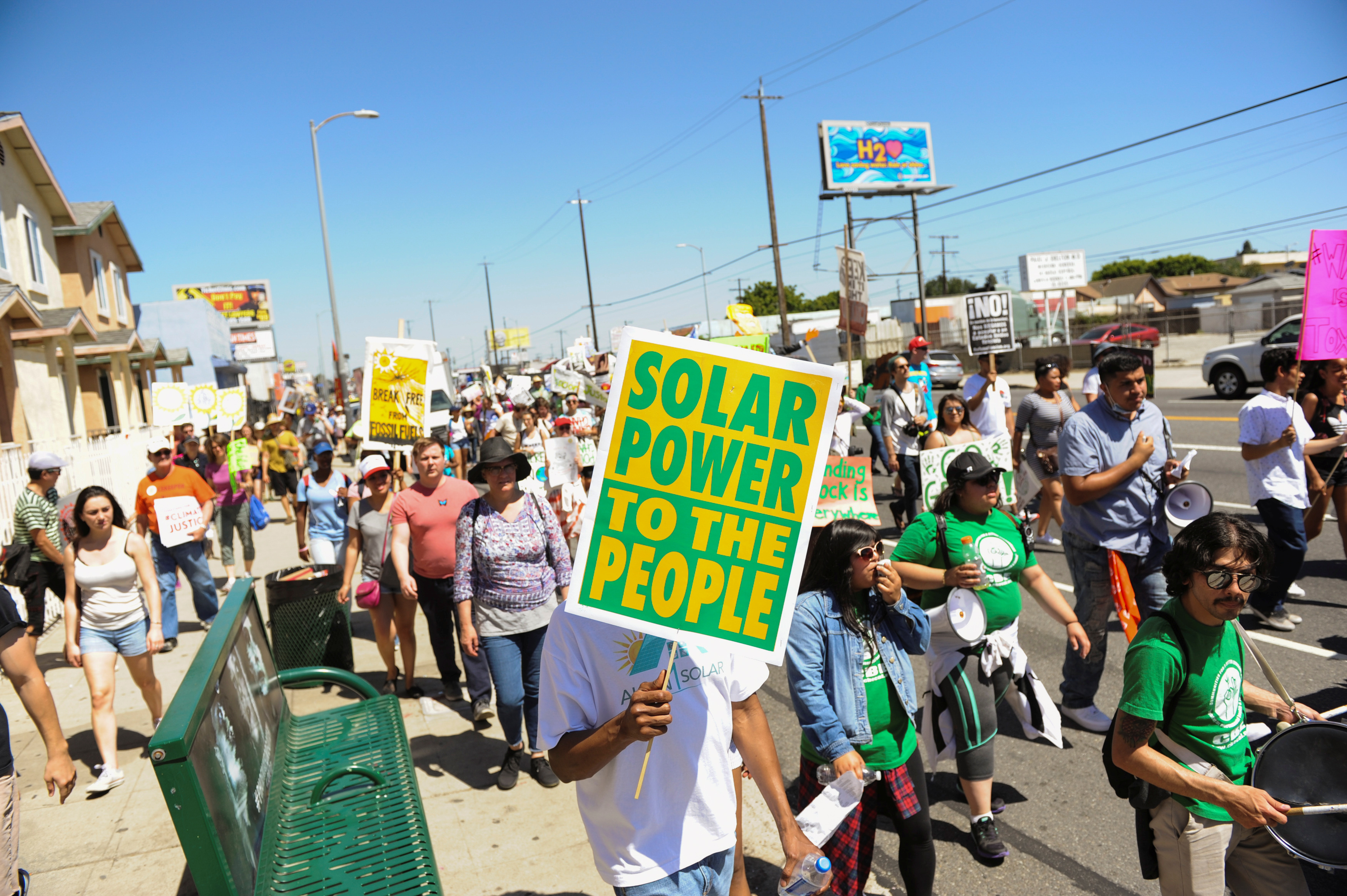 Demonstrators walk on the Pacific Coast highway during People's Climate March protest for the environment in the Wilmington neighborhood in Los Angeles, California, U.S. April 29, 2017. The march, which specifically protested the expansion of a Tesoro refinery, was held in a heavily industrialized neighborhood and was led by environmental leaders from the indigenous and minority communities. REUTERS/Andrew Cullen