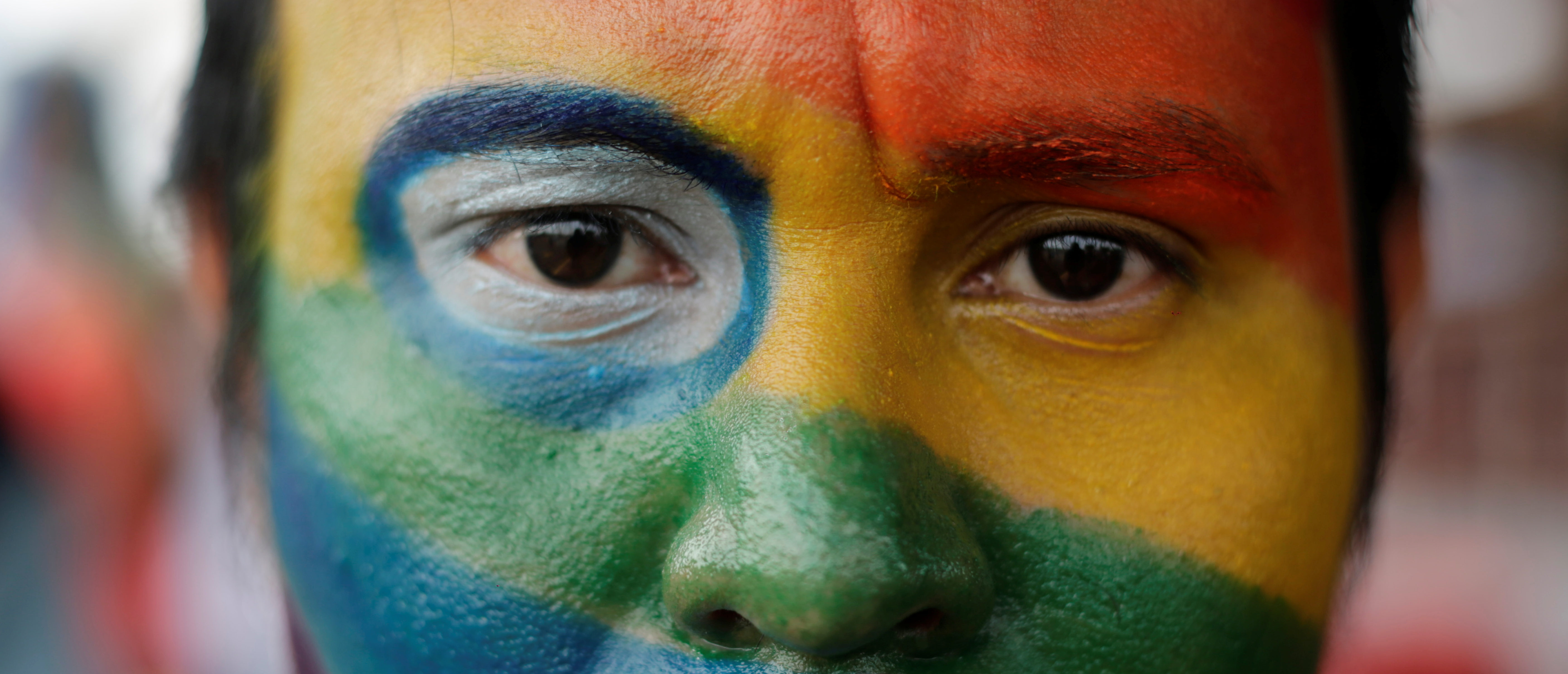 An activist with his face painted in the colours of the rainbow flag participates in a march organized by the LGBT community in Managua, Nicaragua, June 28, 2018. REUTERS/Jorge Cabrera