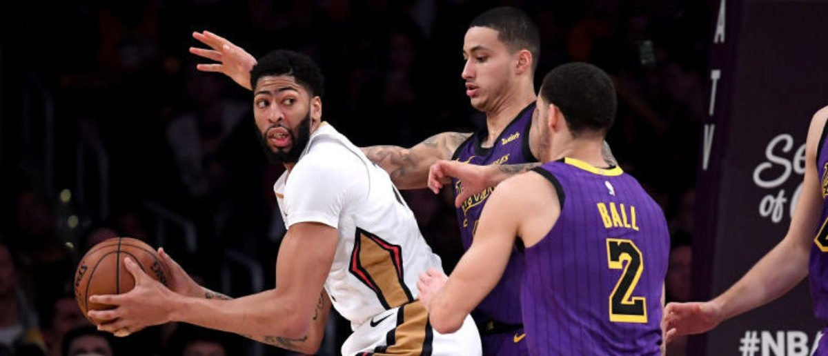 LOS ANGELES, CALIFORNIA - DECEMBER 21: Anthony Davis #23 of the New Orleans Pelicans is defended by Kyle Kuzma #0, Lonzo Ball #2 and Ivica Zubac #40 of the Los Angeles Lakers during a 112-104 Laker win at Staples Center on December 21, 2018 in Los Angeles, California. (Photo by Harry How/Getty Images)