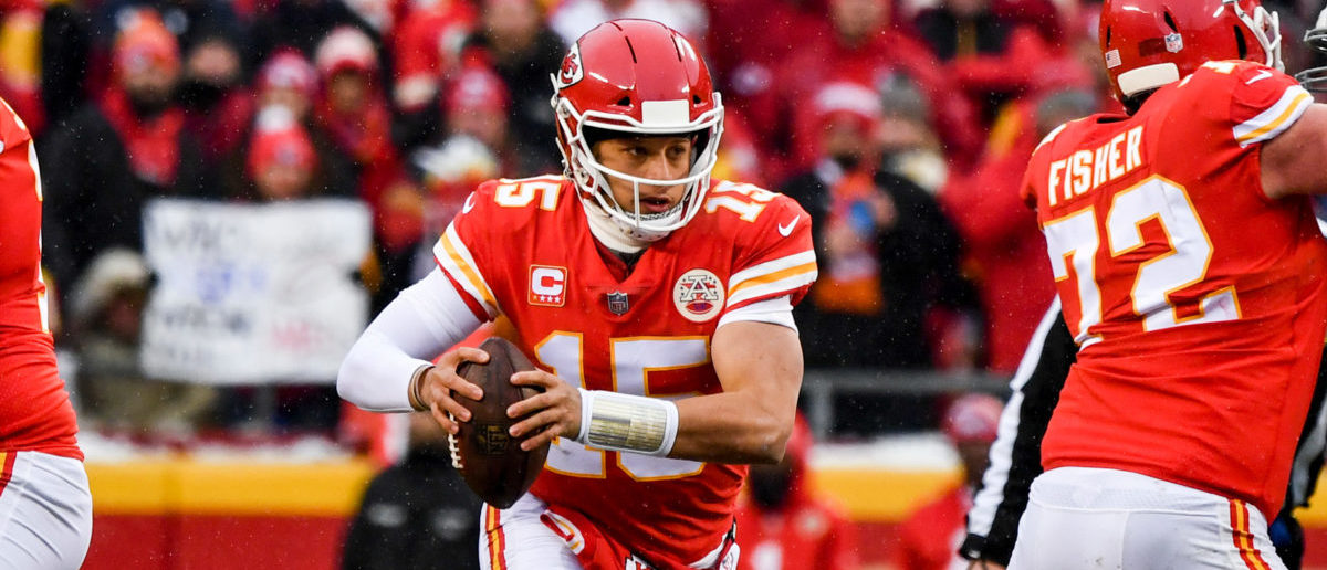KANSAS CITY, MO - JANUARY 12: Patrick Mahomes #15 of the Kansas City Chiefs runs out of the pocket against the Indianapolis Colts during the first quarter of the AFC Divisional Round playoff game at Arrowhead Stadium on January 12, 2019 in Kansas City, Missouri. (Photo by Peter Aiken/Getty Images)