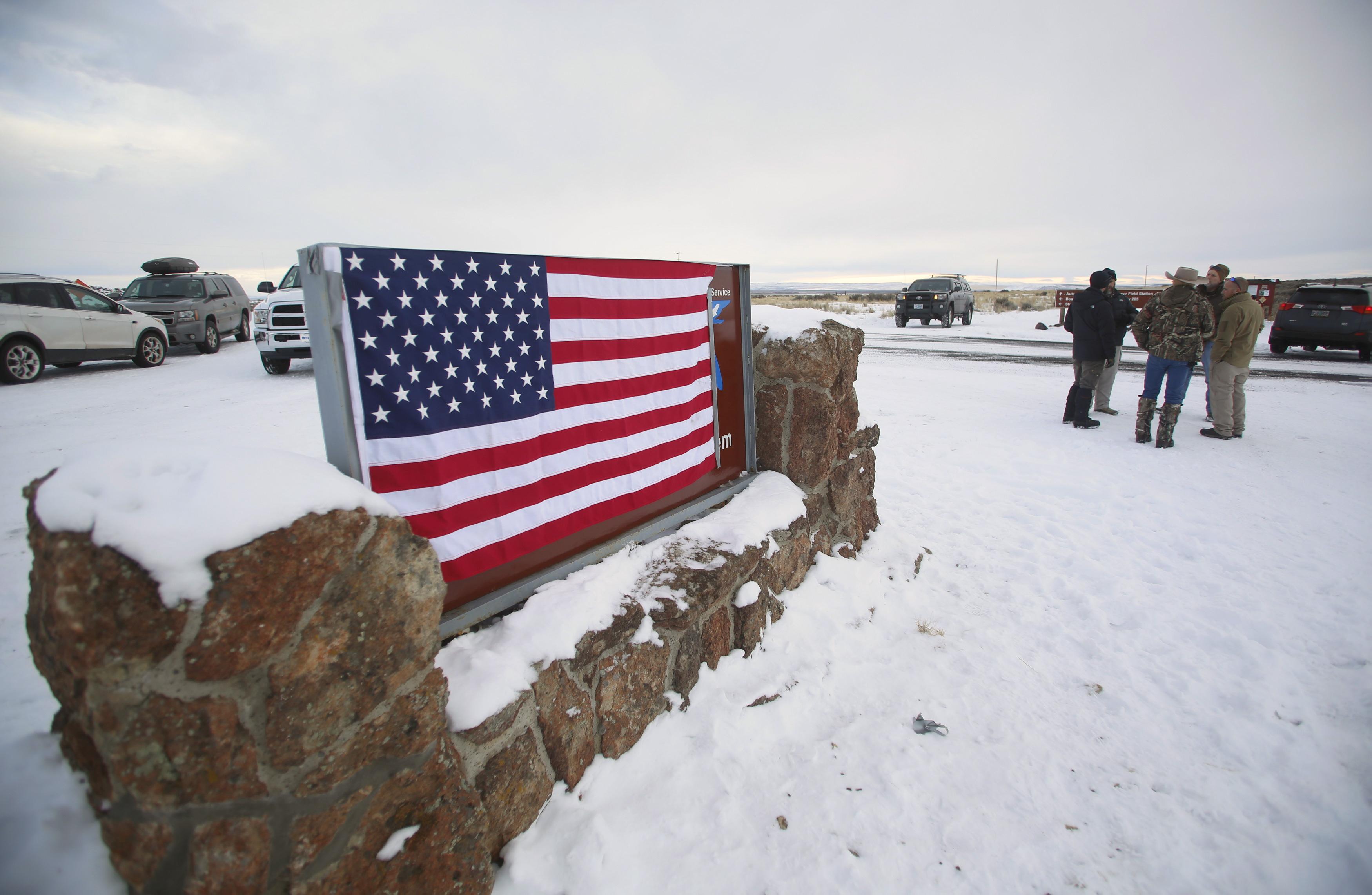 A U.S. flag covers a sign at the entrance of the Malheur National Wildlife Refuge near Burns, Oregon. REUTERS/Jim Urquhart