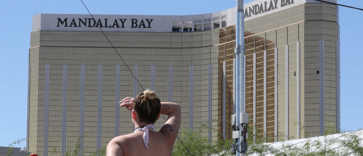 A lady stands by police crime scene tape and looks towards the Mandalay Bay Resort and Casino, near the scene of a mass shooting at the Route 91 Festival in Las Vegas, Nevada, U.S., October 2, 2017. REUTERS/Lucy Nicholson