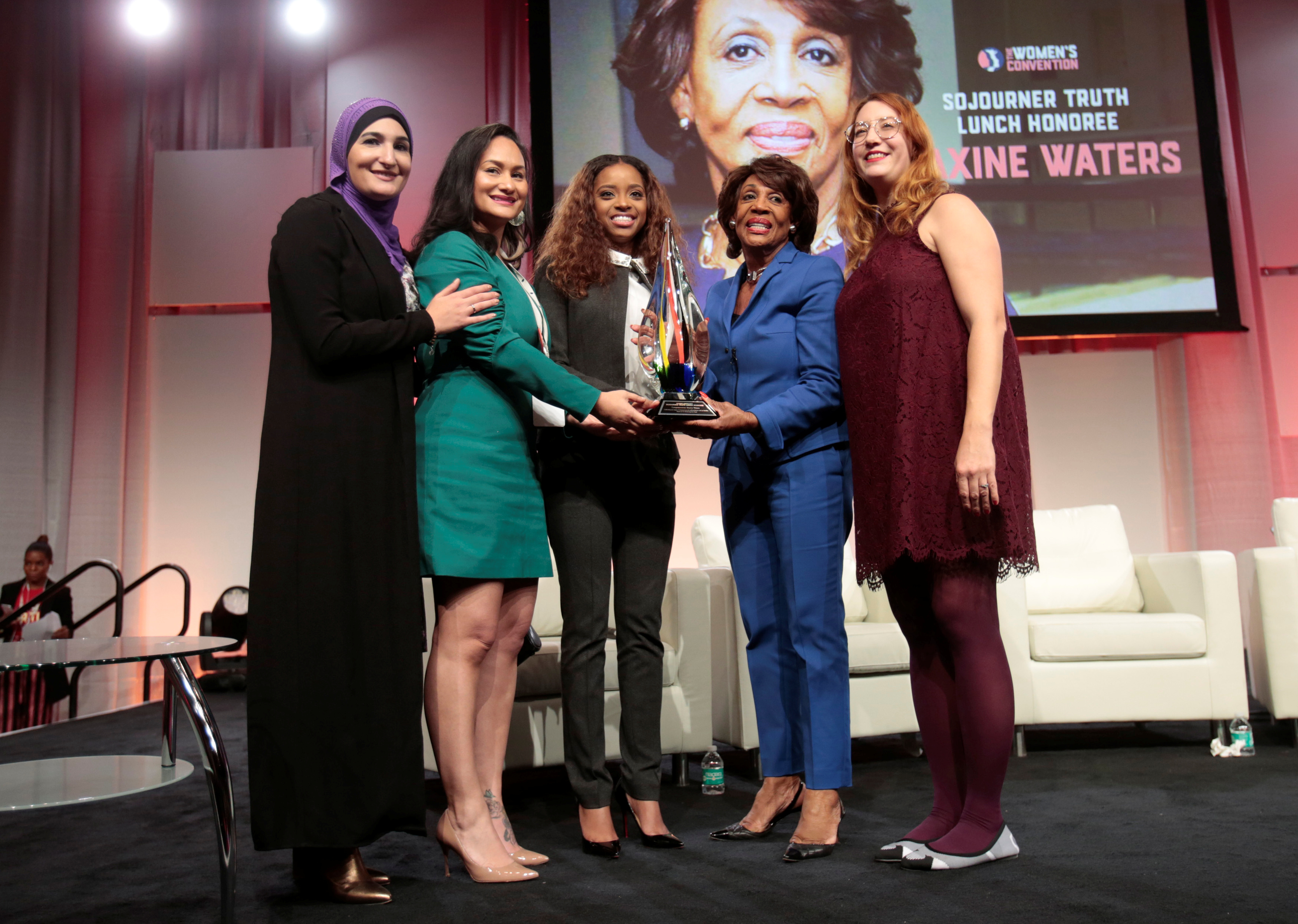 Democratic Rep. Maxine Waters poses with National Co-Chairs.Women's March Linda Sarsour, Carmen Perez, Tamika Mallory and Bob Bland following the Sojourner Truth Luncheon during the three-day Women's Convention at Cobo Center in Detroit, Michigan, U.S., October 28, 2017. REUTERS/Rebecca Cook