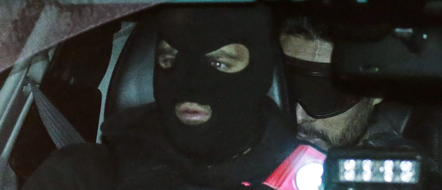 French defendant Mehdi Nemmouche (R) sits at the back of a police vehicle as he arrives at the courthouse in Brussels on December 20, 2018 for a preliminary hearing designed to finalise a list of 150 to 200 witnesses, ahead of his trial on charge of shooting four people dead at a Jewish museum after his return from Syria's battlefields. (THIERRY ROGE/AFP/Getty Images)