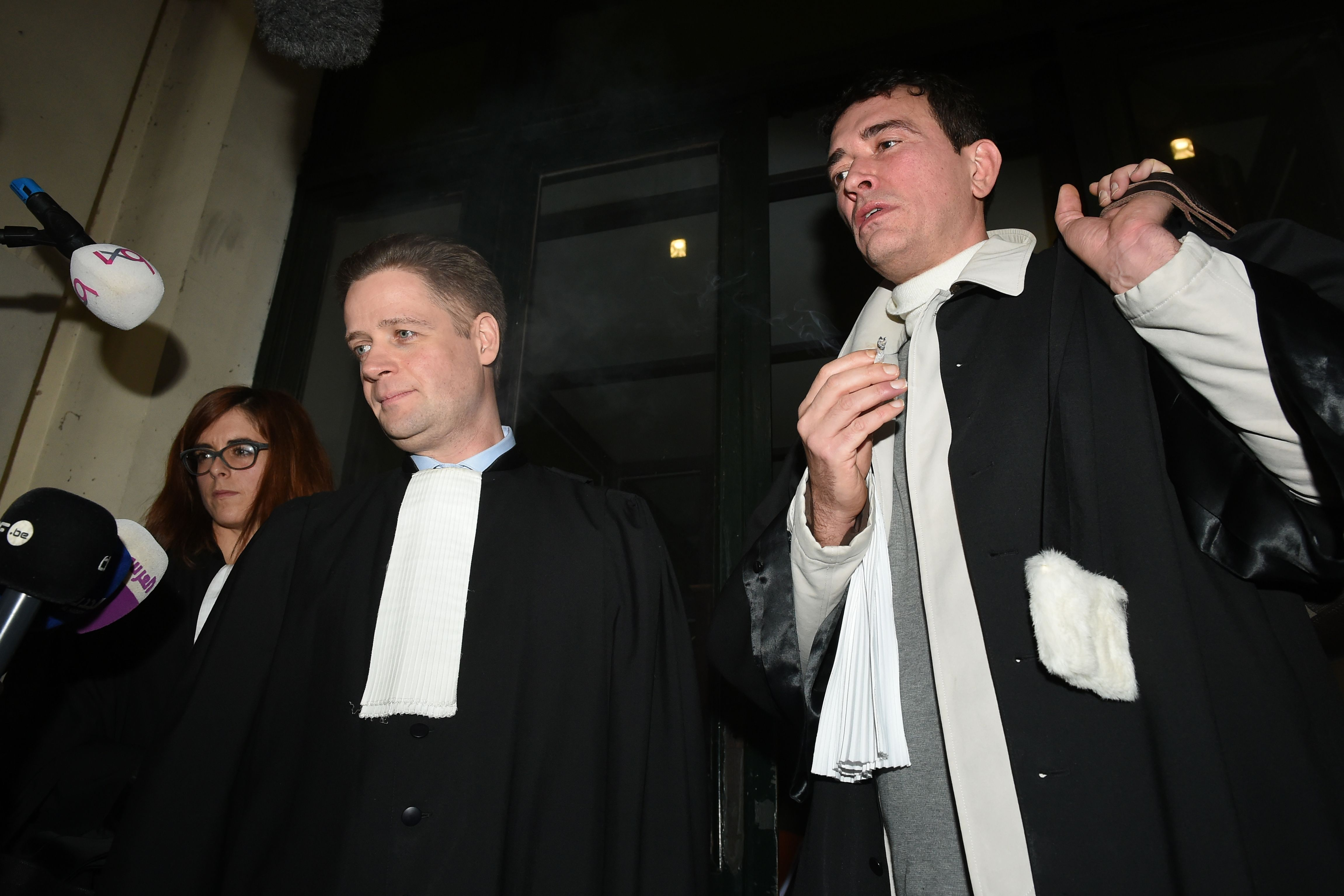 Belgian lawyers of Mehdi Nemmouche, the French suspect in Brussels Jewish museum attack, Henri Laquay (L) and Sebastien Courtoy answer to journalists as they leave the courthouse in Brussels on December 20, 2018 after a preliminary hearing designed to finalise a list of 150 to 200 witnesses, ahead of his trial on charge of shooting four people dead at a Jewish museum after his return from Syria's battlefields. - Nemmouche, who allegedly became the first jihadist from Syria to stage a terror attack on European soil, will be tried next month along with co-defendant Nacer Bendrer. (JOHN THYS/AFP/Getty Images)