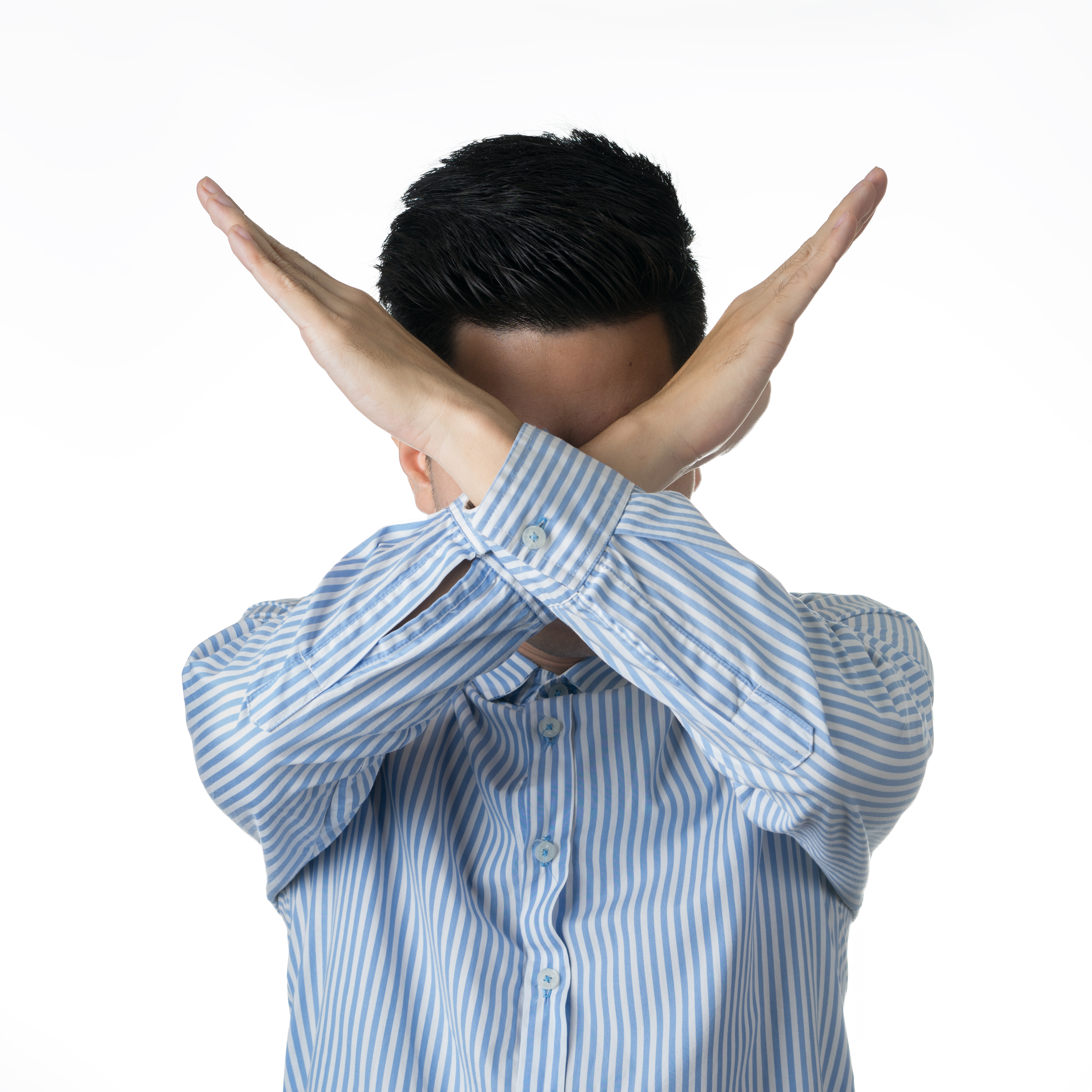 Pictured is a man gesturing an X. SHUTTERSTOCK/ NarongchaiHlaw