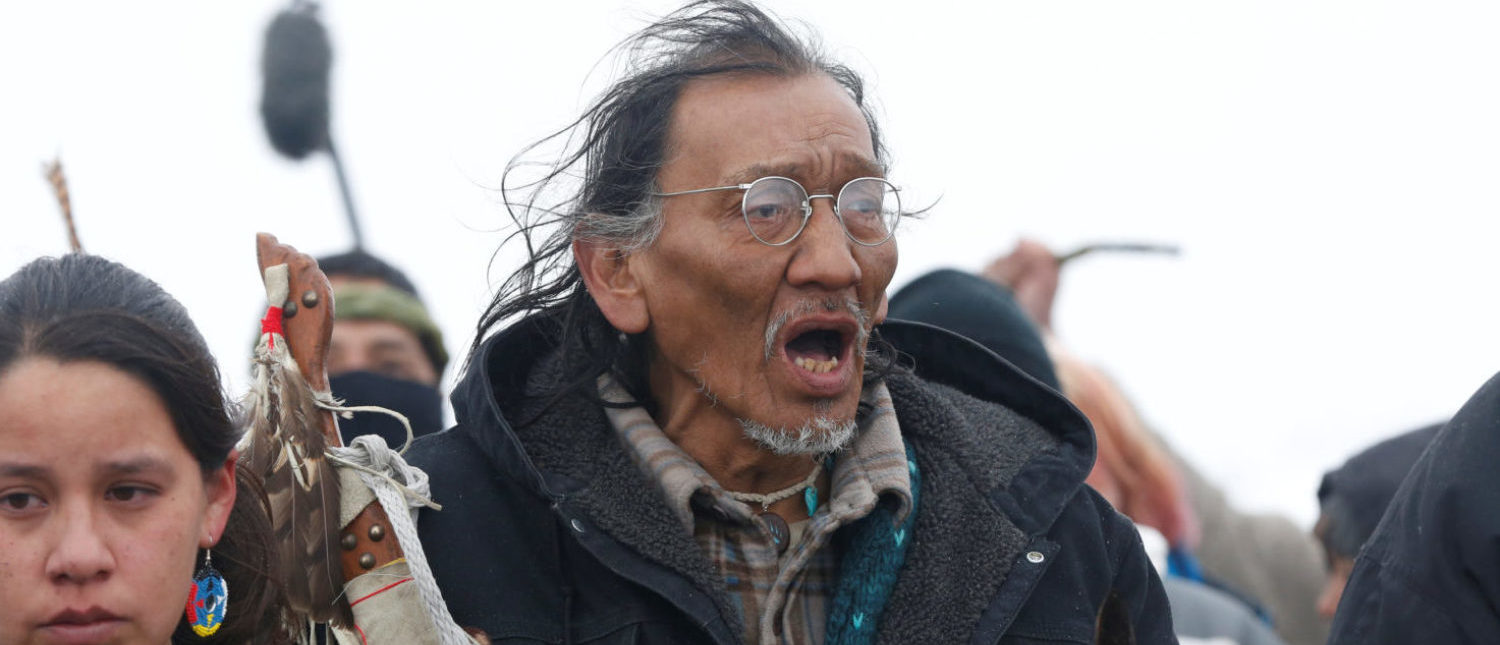 Nathan Phillips marches with other protesters out of the main opposition camp against the Dakota Access oil pipeline near Cannon Ball, North Dakota, U.S., February 22, 2017. Picture taken February 22, 2017. REUTERS/Terray Sylvester
