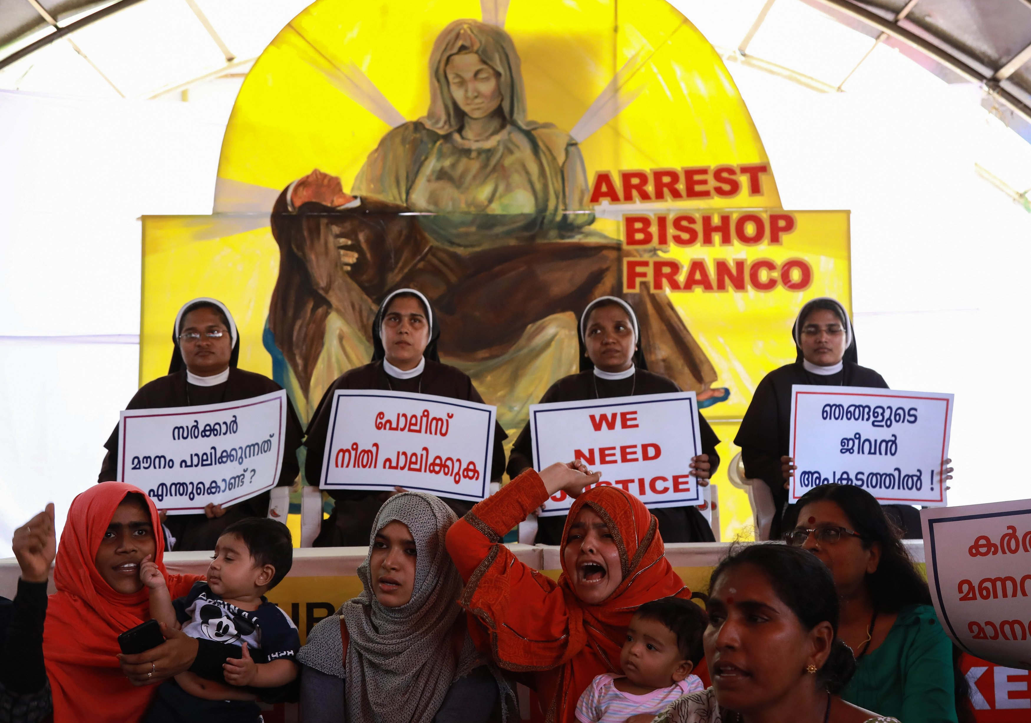 Indian Christian nuns and Muslim supporters protest as they demand the arrest of Bishop Franco Mulakkal, who is accused of raping a nun, outside the High Court in Kochi in the southern Indian state of Kerala on September 13, 2018. (/AFP/Getty Images)