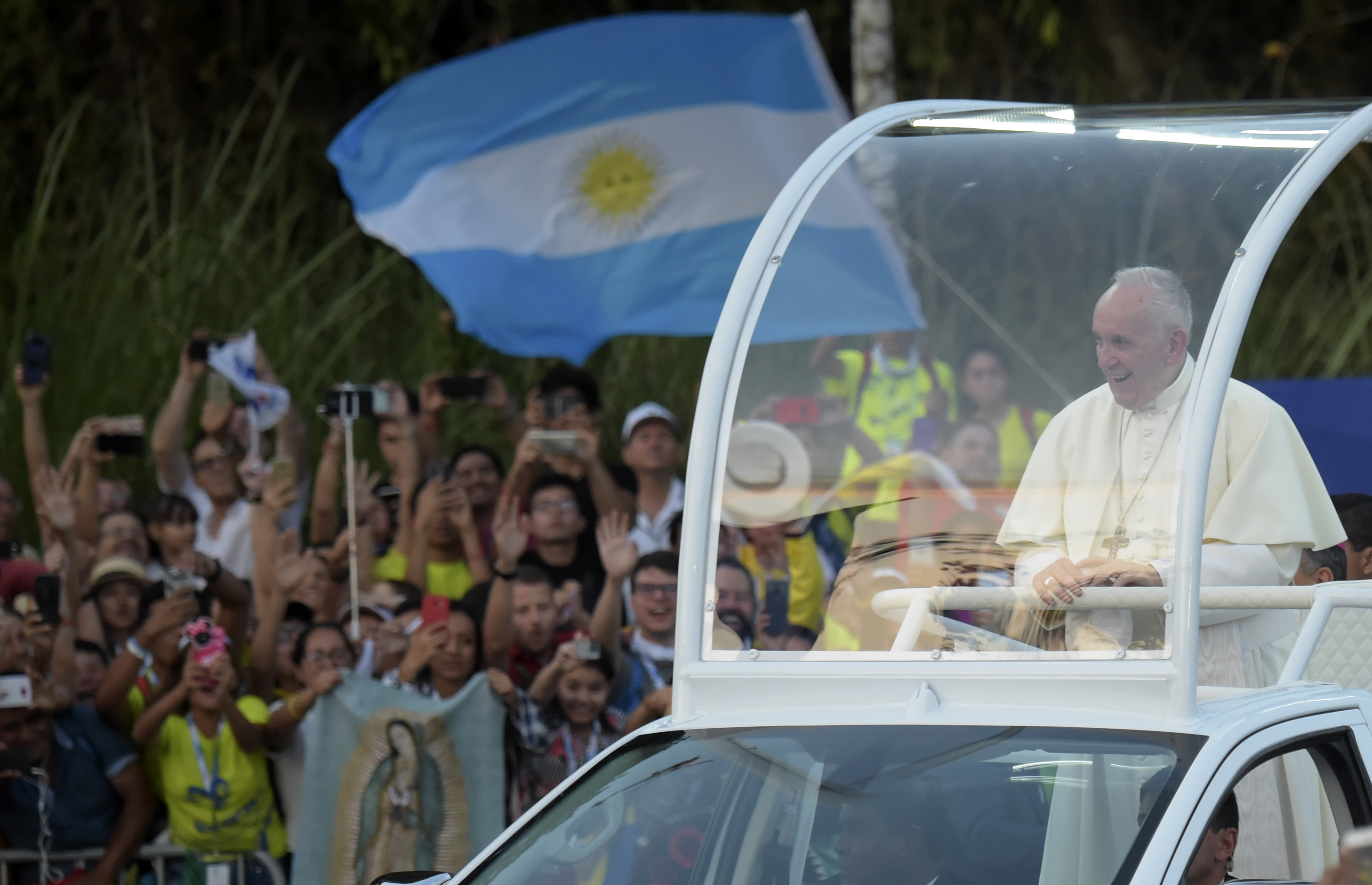 Pope Francis arrives at the nunciature on the popemobile after coming to Panama City for World Youth Day, on January 23, 2019. (RAUL ARBOLEDA/AFP/Getty Images)