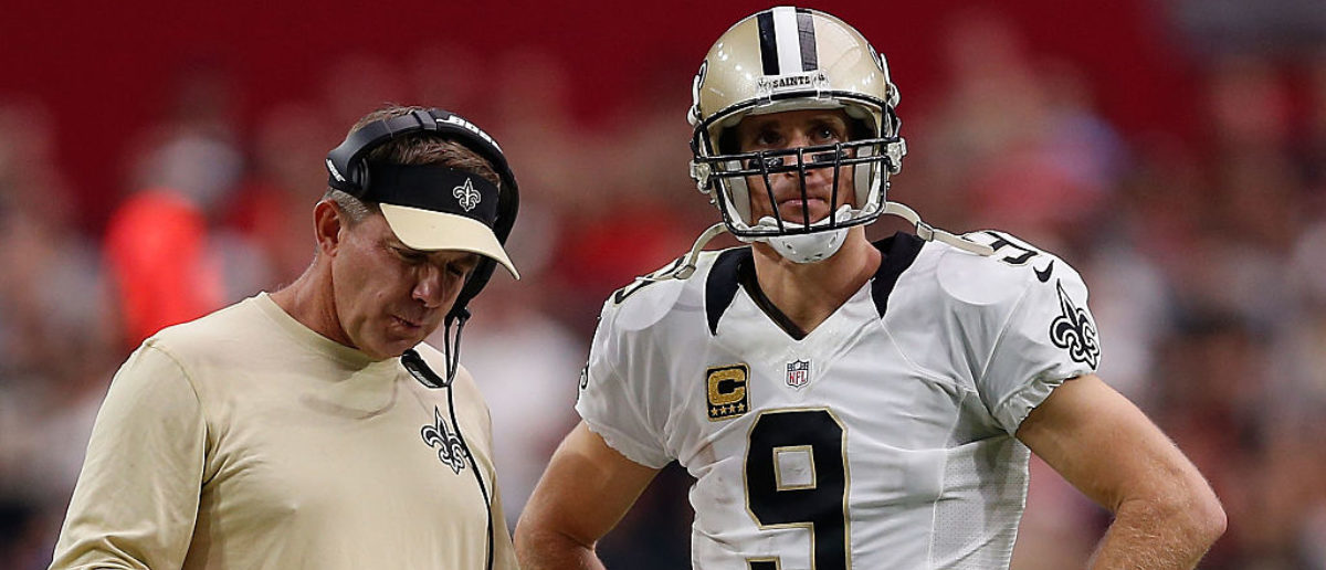 GLENDALE, AZ - SEPTEMBER 13: Head coach Sean Payton of the New Orleans Saints (left) talks with quarterback Drew Brees #9 during the second half of the NFL game against the Arizona Cardinals at the University of Phoenix Stadium on September 13, 2015 in Glendale, Arizona. The Cardinals defeated the Saints 31-19. (Photo by Christian Petersen/Getty Images)
