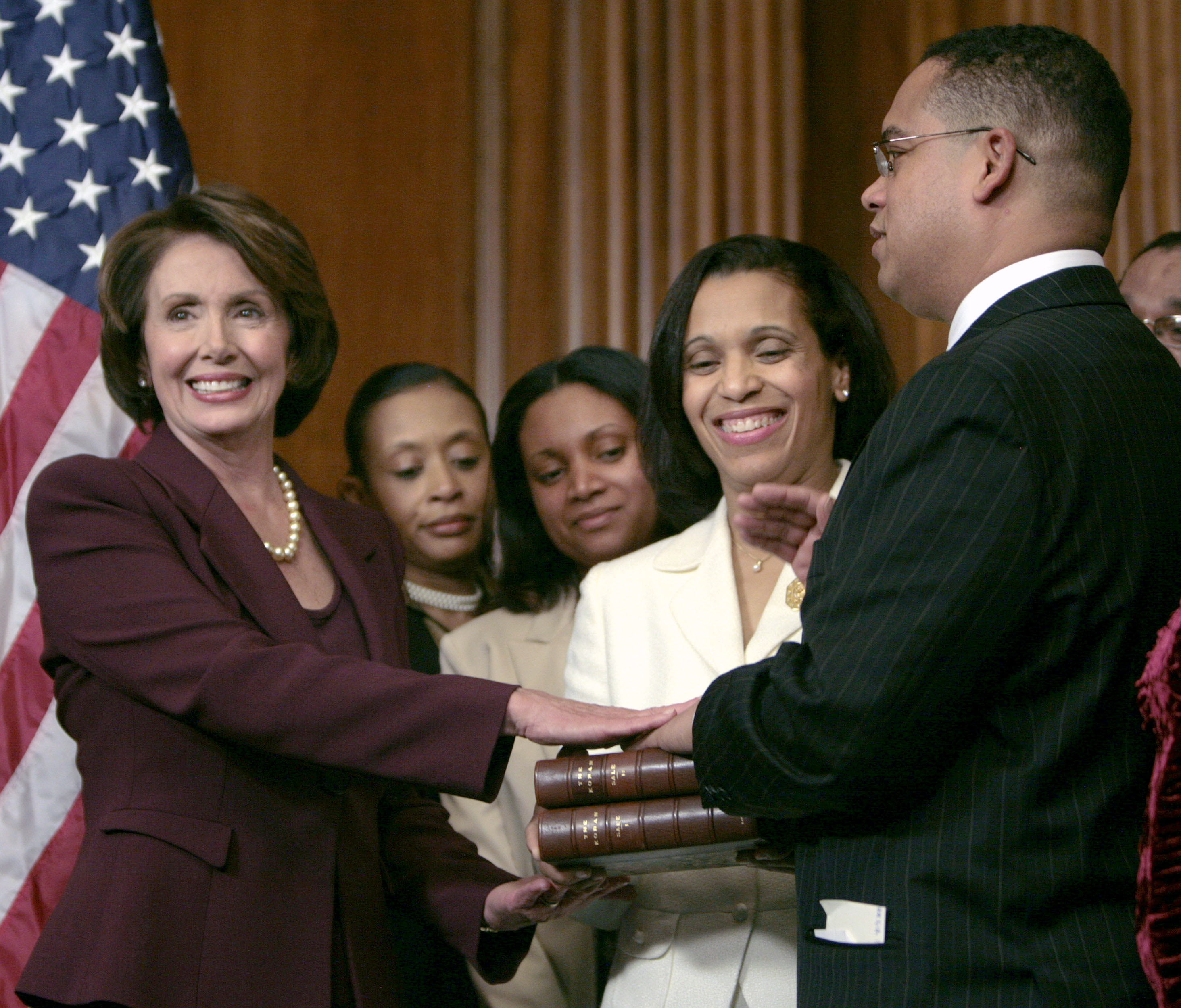 U.S. Rep. Keith Ellison (D-MN) places his hand on an English translation of the Koran once owned by Thomas Jefferson and held by his wife Kim (C) as he is sworn in as the first Muslim member of Congress by Speaker of the House Nancy Pelosi on Captitol Hill in Washington, January 4th, 2007. REUTERS/Jim Young