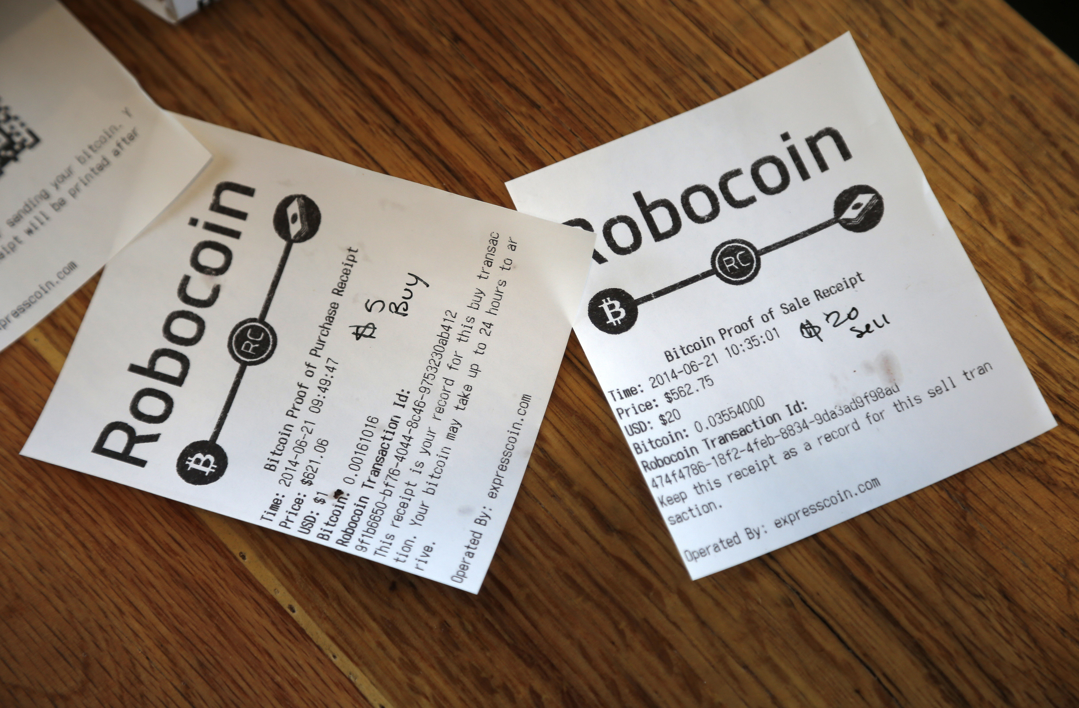 Bitcoin ATM receipts lie on a table inside Locali Conscious Convenience store, where one of Southern California's first two bitcoin-to-cash ATMs began operating today, in Venice