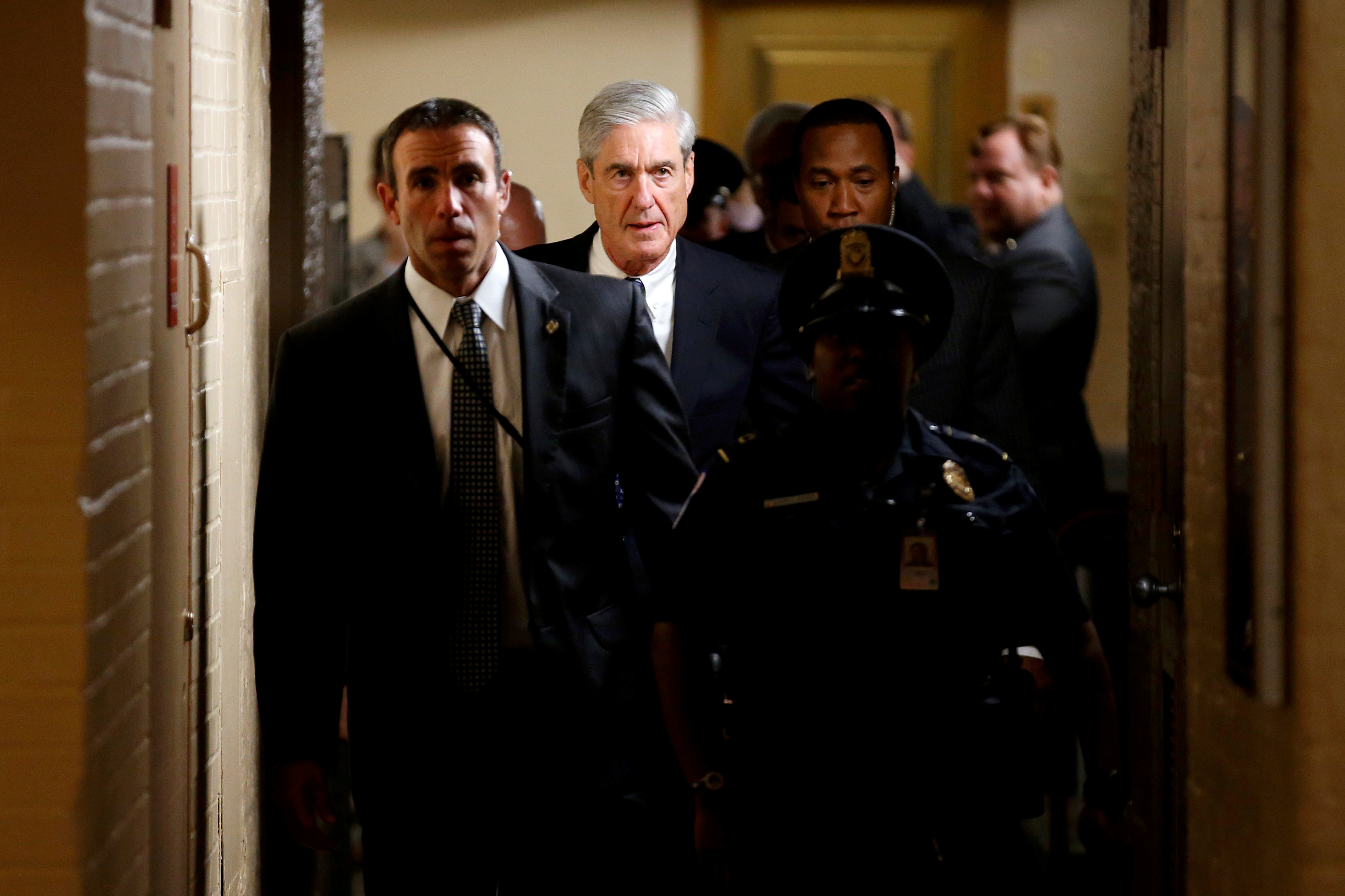Special Counsel Robert Mueller departs surrounded by police and security after briefing members of the U.S. Senate on his investigation into potential collusion between Russia and the Trump campaign on Capitol Hill in Washington, U.S., June 21, 2017. REUTERS/Joshua Roberts