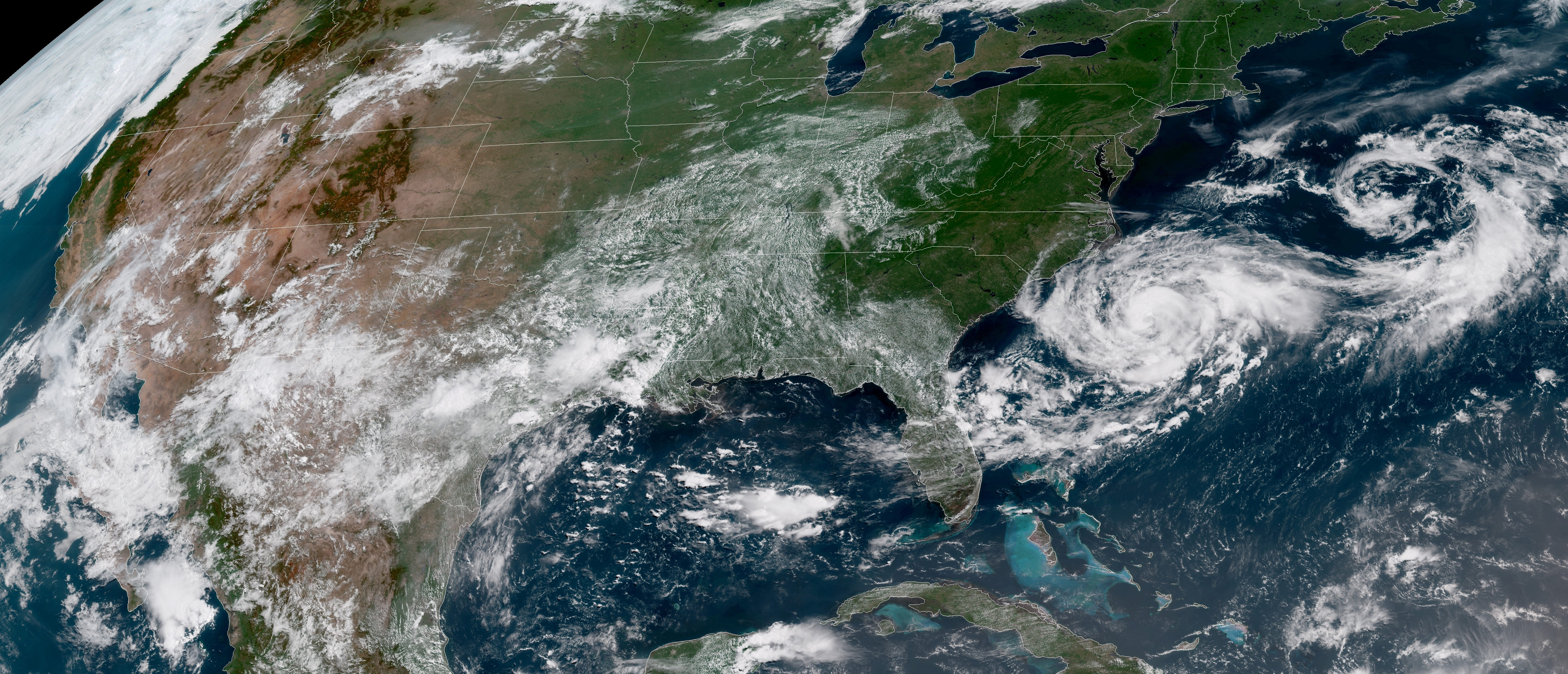Tropical Storm Chris is shown off the eastern coast of North and South Carolina, U.S., in this satellite image July 9, 2018 at 16:12 UTC. NOAA/Goes-East Imagery/Handout via REUTERS.