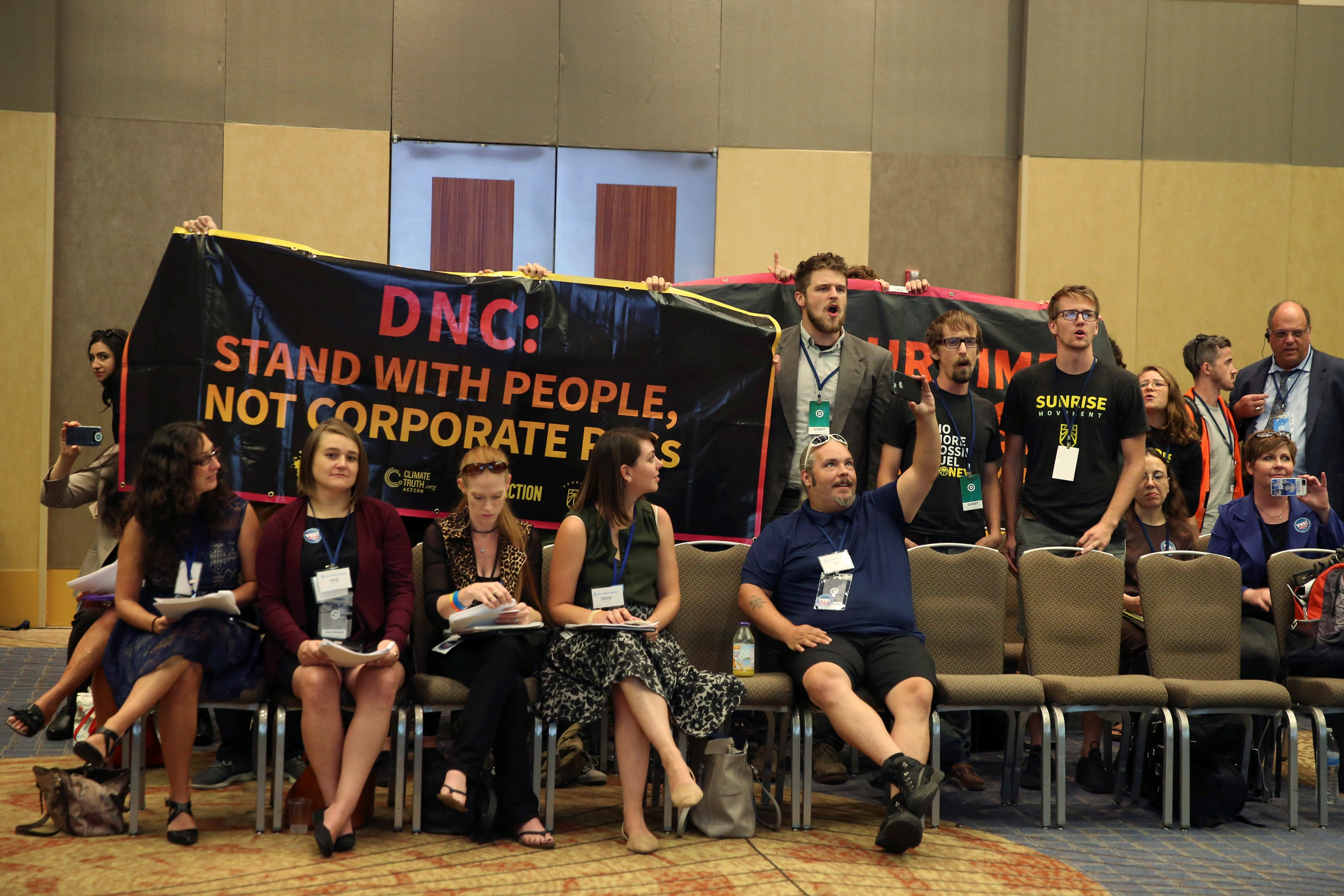 Demonstrators interrupt the DNC Summer Meeting in Chicago
