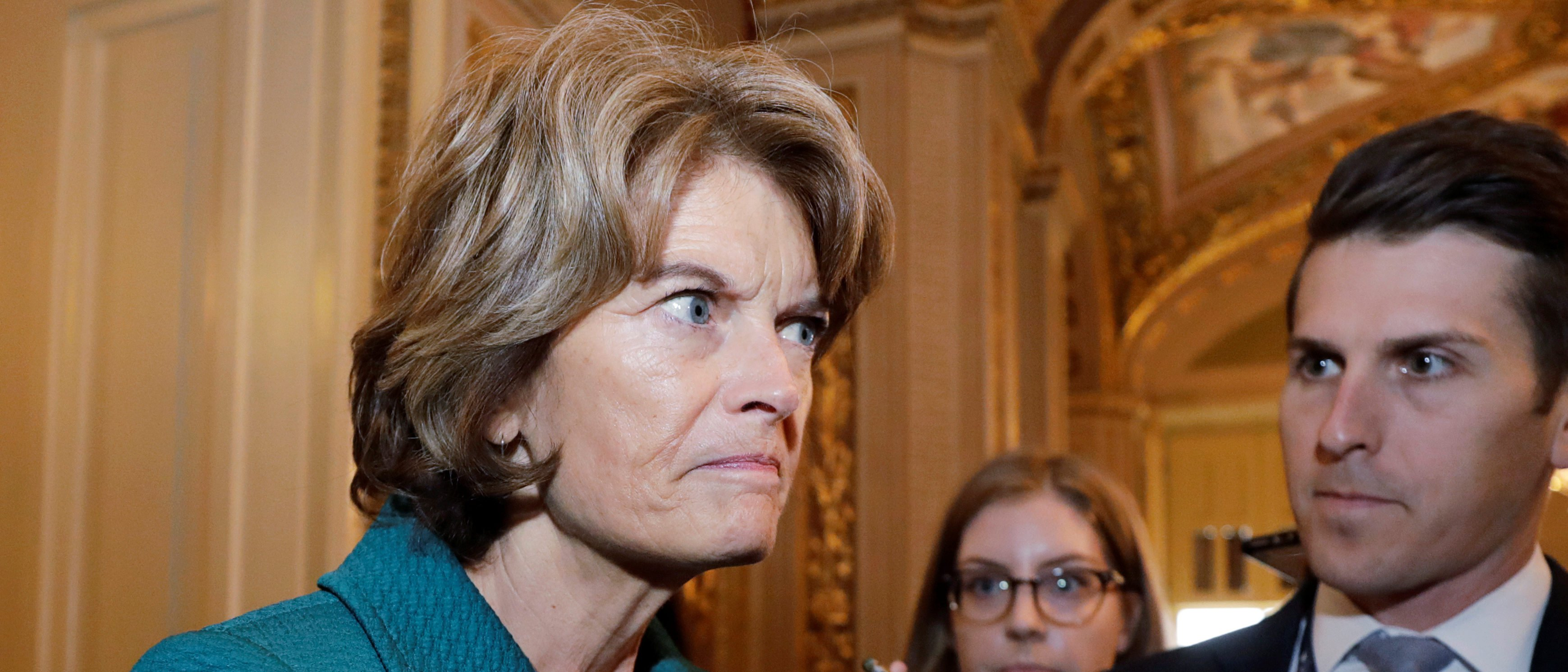 "Senator Lisa Murkowski (R-AK) talks to reporters about her ""no"" vote after a procedural vote in the U.S. Senate on the confirmation of U.S. Supreme Court nominee judge Brett Kavanaugh on Capitol Hill in Washington, U.S., October 5, 2018. REUTERS/Yuri Gripas."