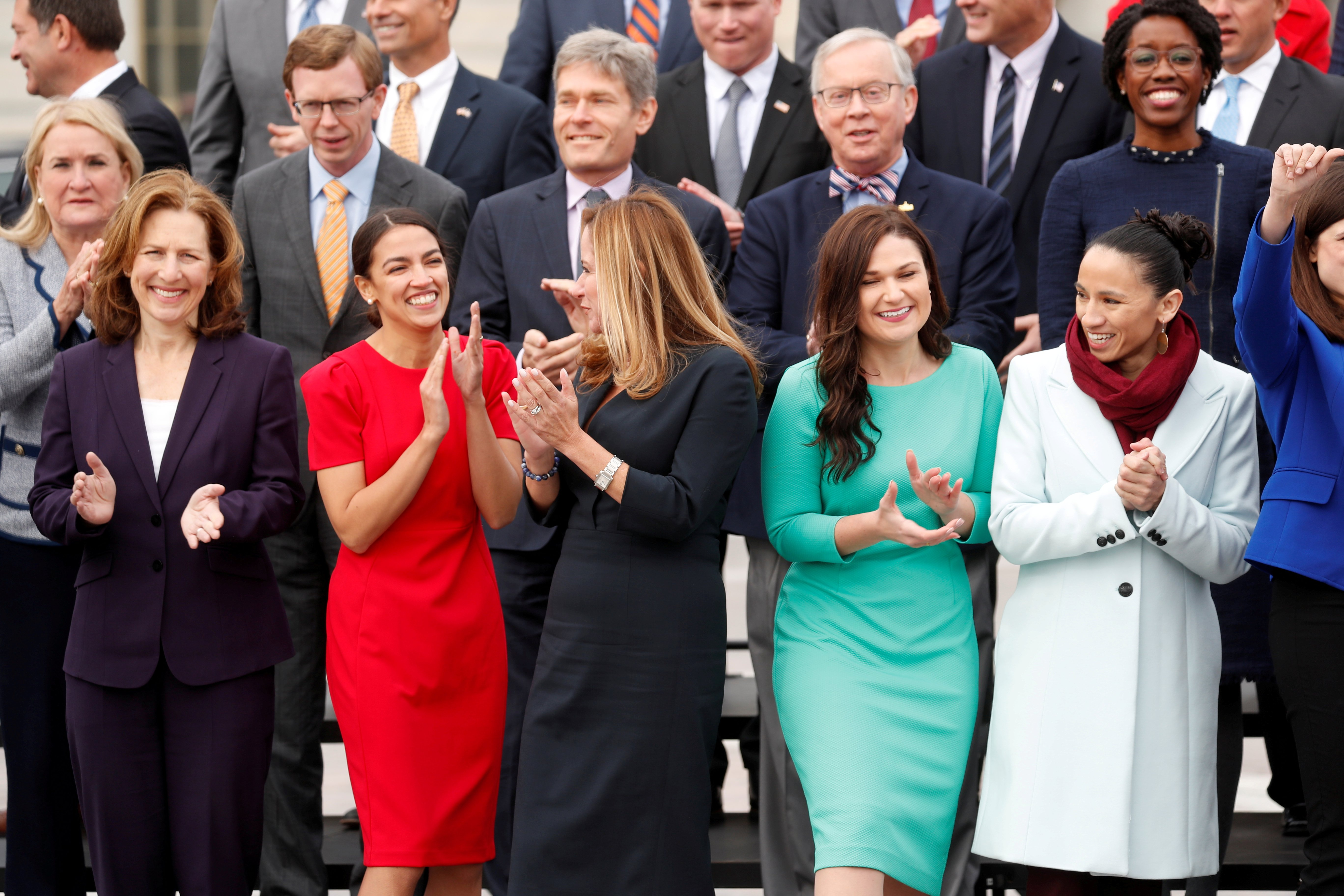 Female Democratic Representatives-elect pose together in front row of class picture on Capitol Hill in Washington