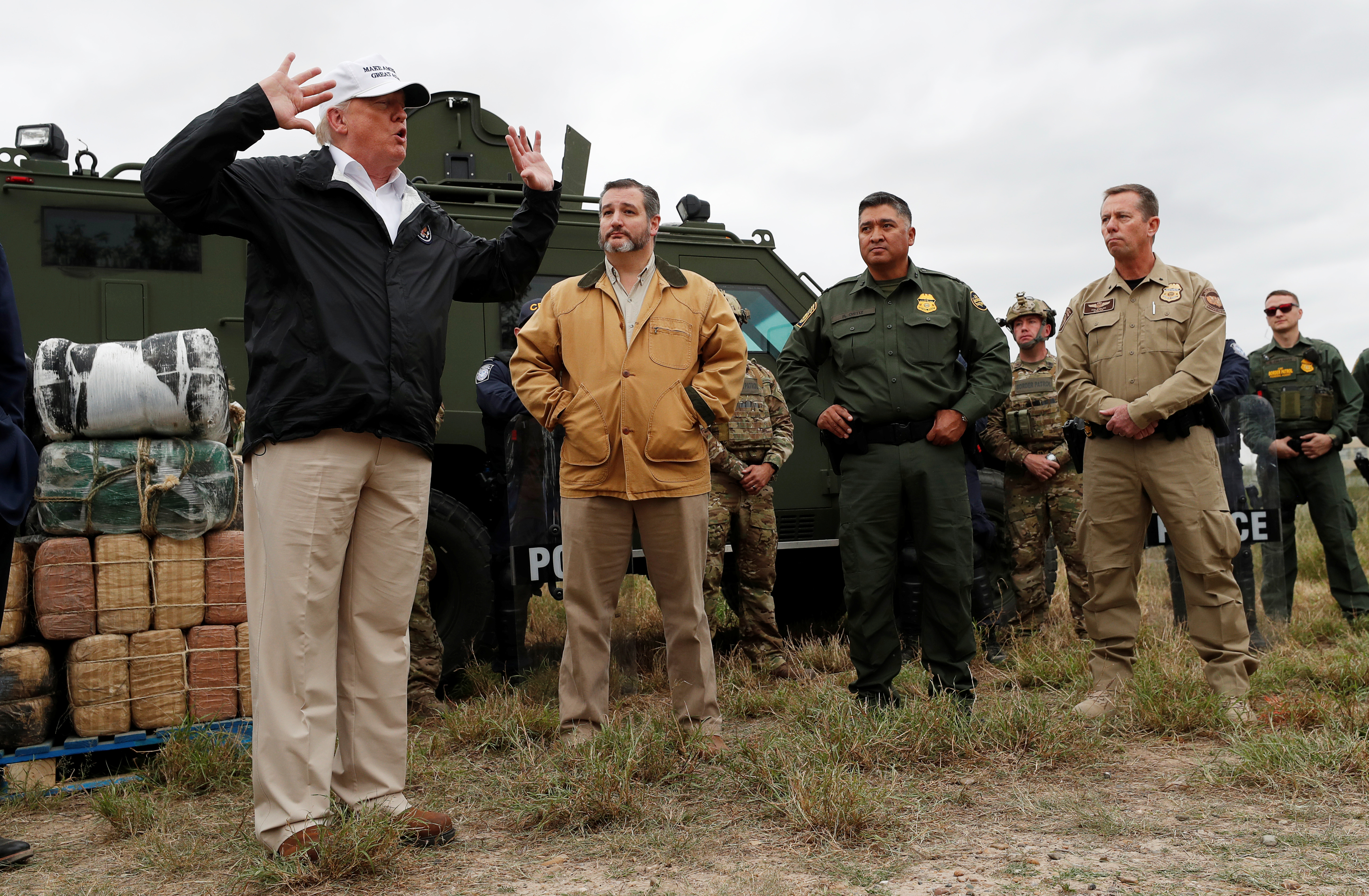 President Donald Trump speaks to reporters as he visits the banks of the Rio Grande River with Senator Ted Cruz and U.S. Customs and Border Patrol officers and agents during the president's visit to the U.S. - Mexico border in Mission, Texas, U.S., January 10, 2019. REUTERS/Leah Millis