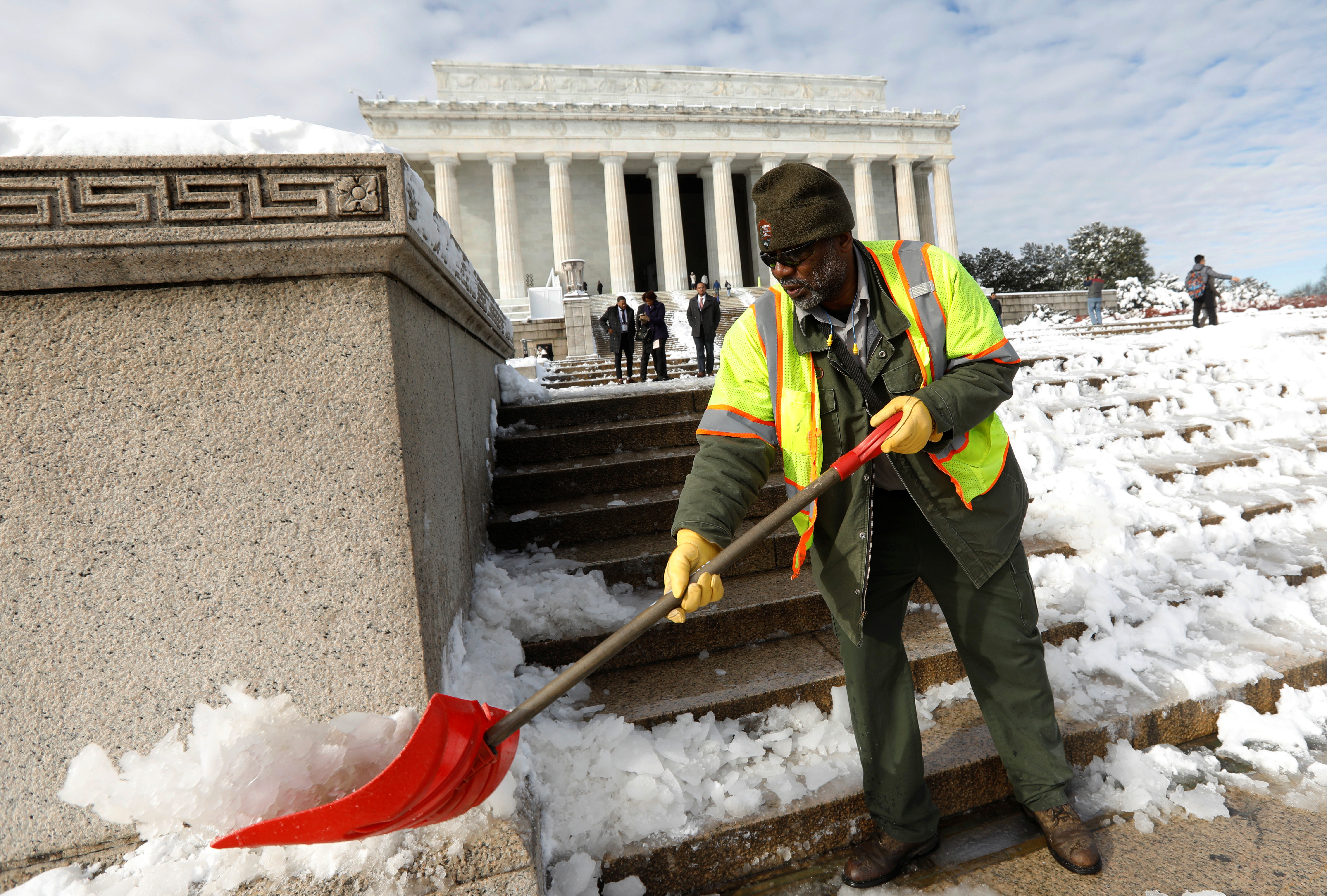 Furloughed National Park Service employee cleans the steps of the Lincoln Memorial on day 24 of the government shutdown, in Washington