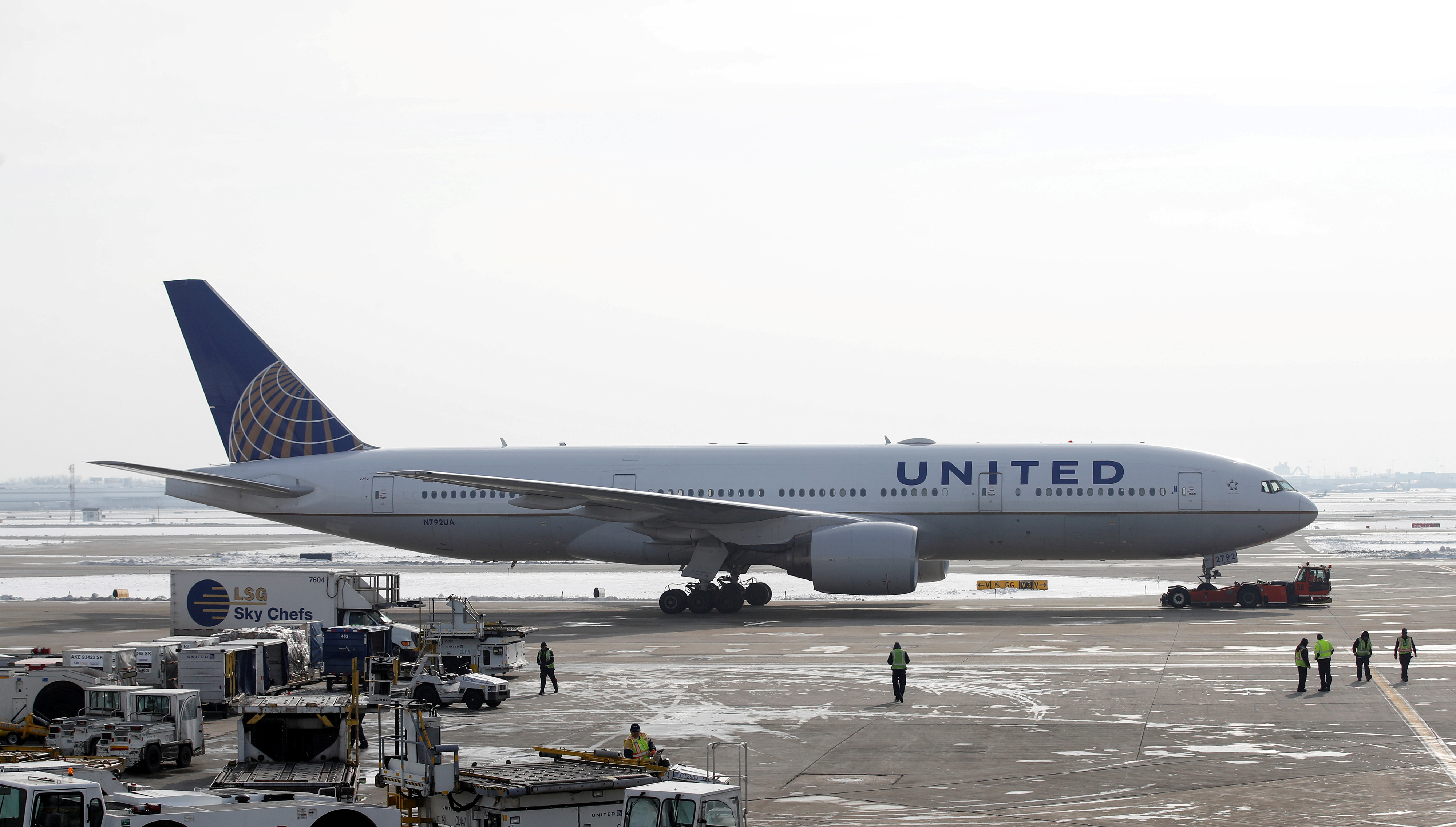 A United Airlines Boeing 777 plane is towed at O'Hare International Airport in Chicago