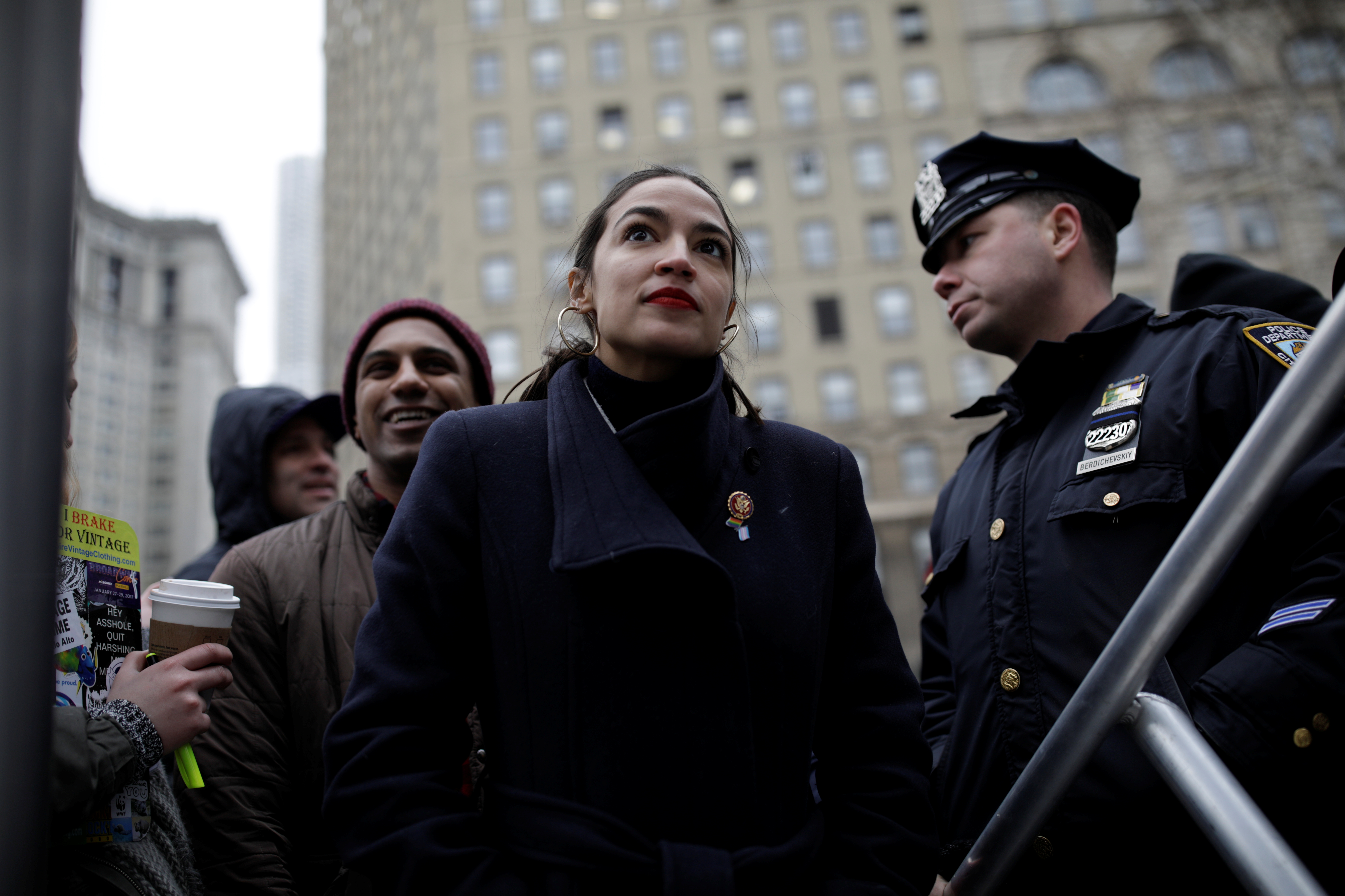 Representative Alexandria Ocasio-Cortez looks on as she awaits to be introduced to the crowd of supporters during the Women's March NYC demonstration at Foley Square in the Manhattan borough of New York City