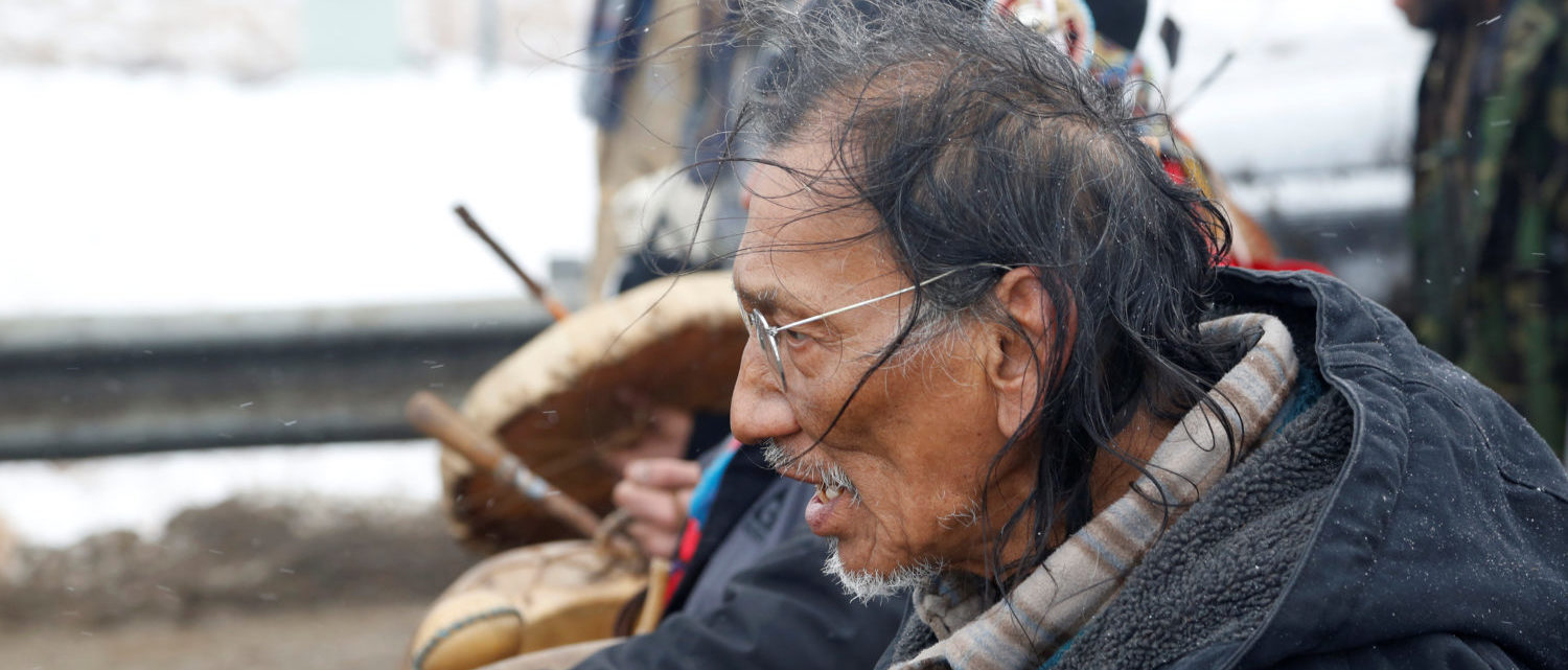 Nathan Phillips marches with other protesters out of the main opposition camp against the Dakota Access oil pipeline near Cannon Ball, North Dakota, U.S., February 22, 2017. REUTERS/Terray Sylvester