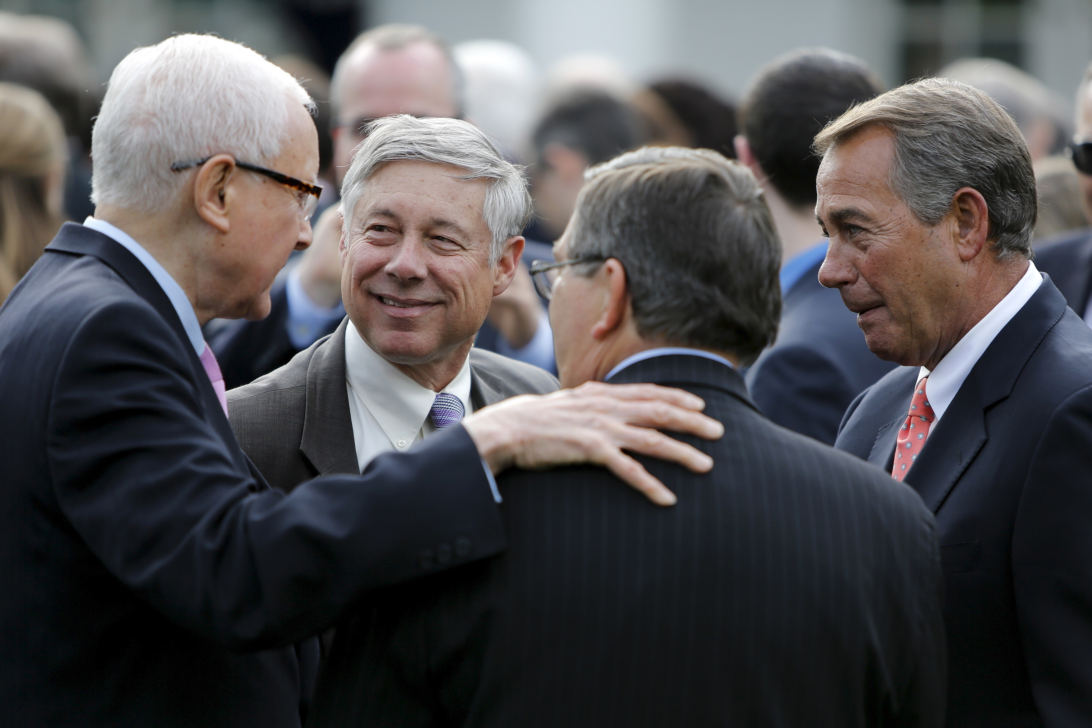U.S. Senator Orrin Hatch (R-UT) (L) speaks with Representative Fred Upton (R-MI) (2nd L) and House Speaker John Boehner (R-OH) (R) at a reception for supporters of H.R. 2, the Medicare Access and CHIP Reauthorization Act of 2015 in the Rose Garden at the White House in Washington April 21, 2015. REUTERS/Jonathan Ernst