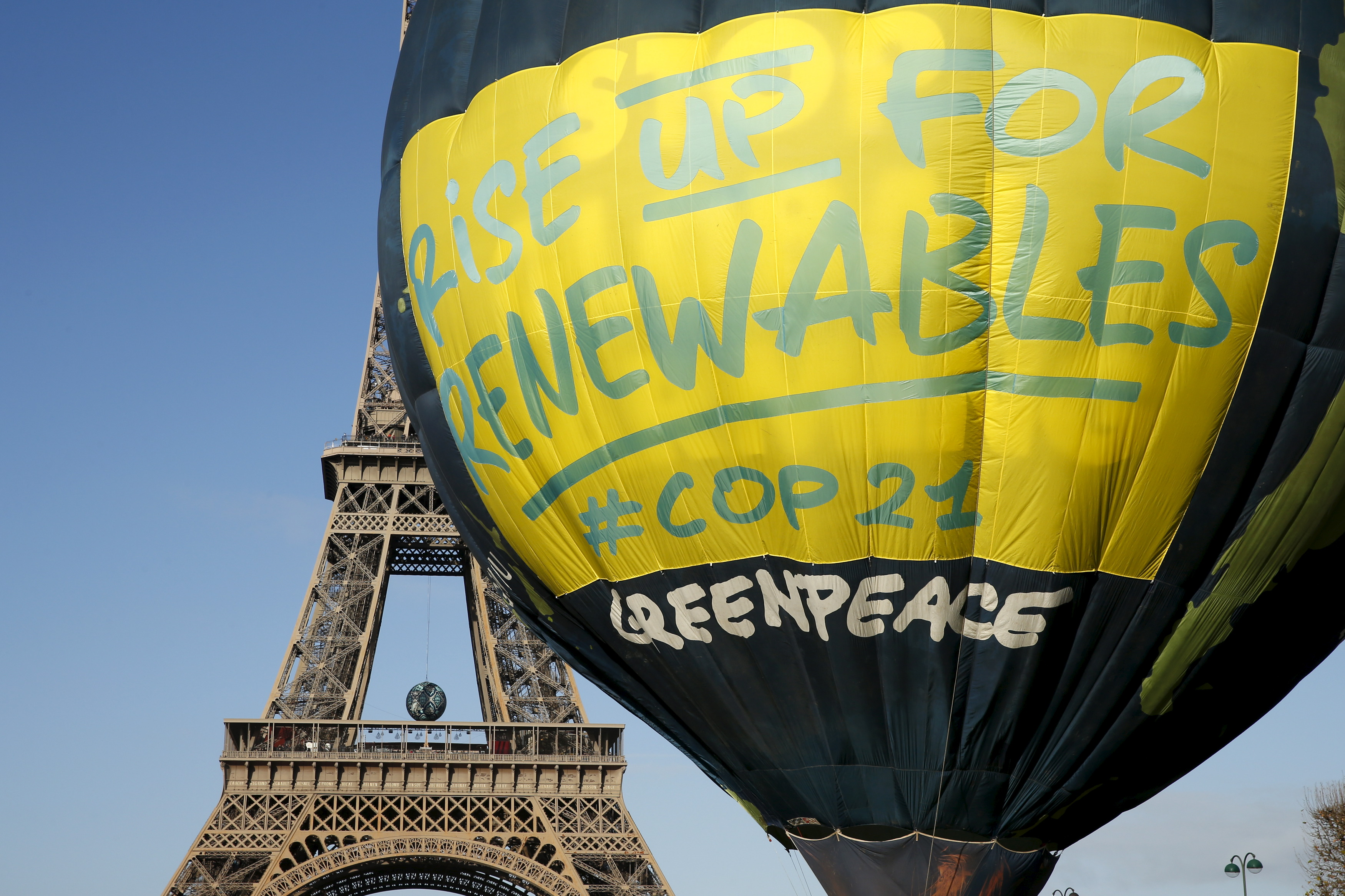 Greenpeace activists fly a hot air balloon depicting the globe next to the Eiffel Tower ahead of the 2015 Paris Climate Conference, known as the COP21 summit, in Paris