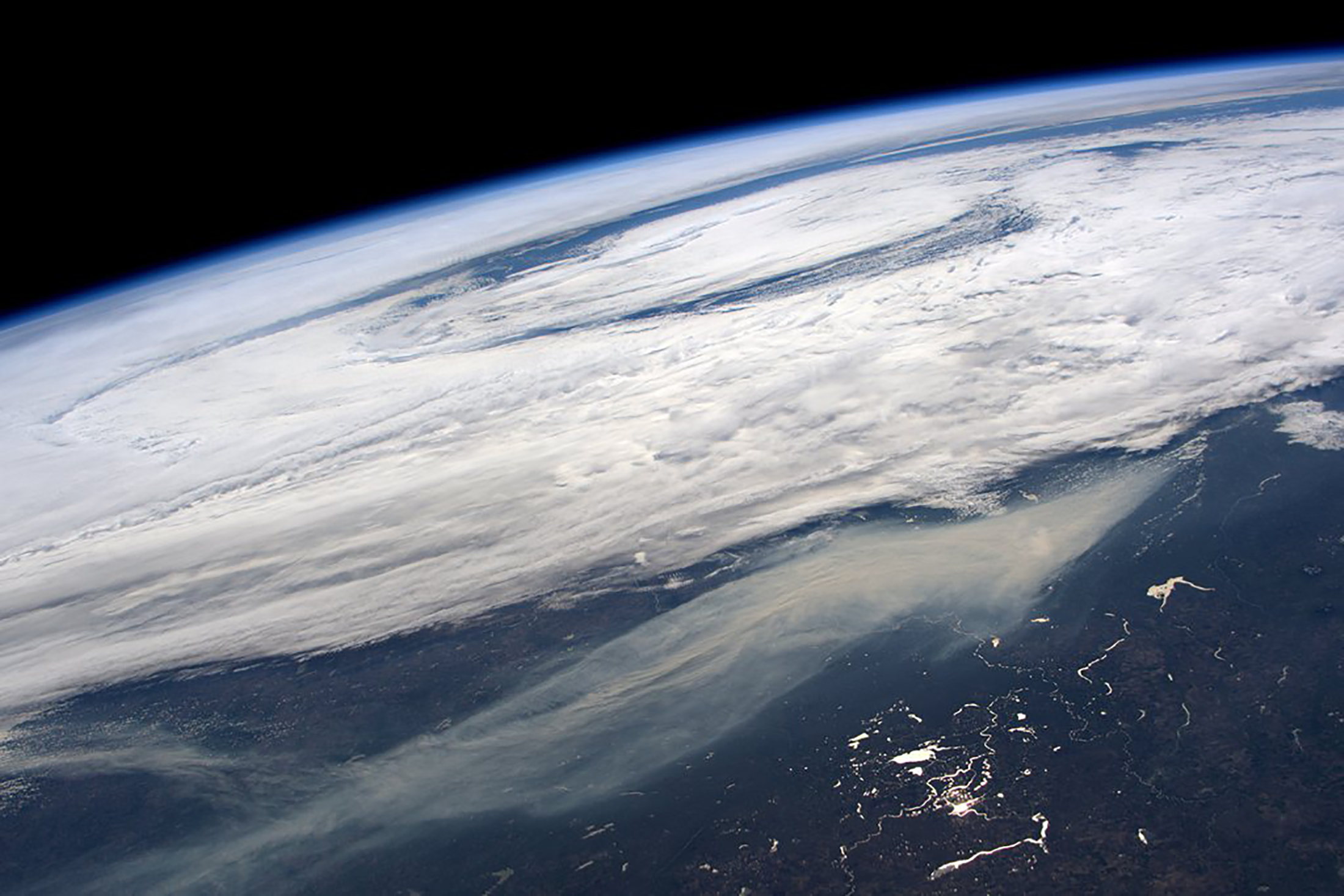 The smoke plume from large wildfires in and around Ft McMurray is seen from International Space Station