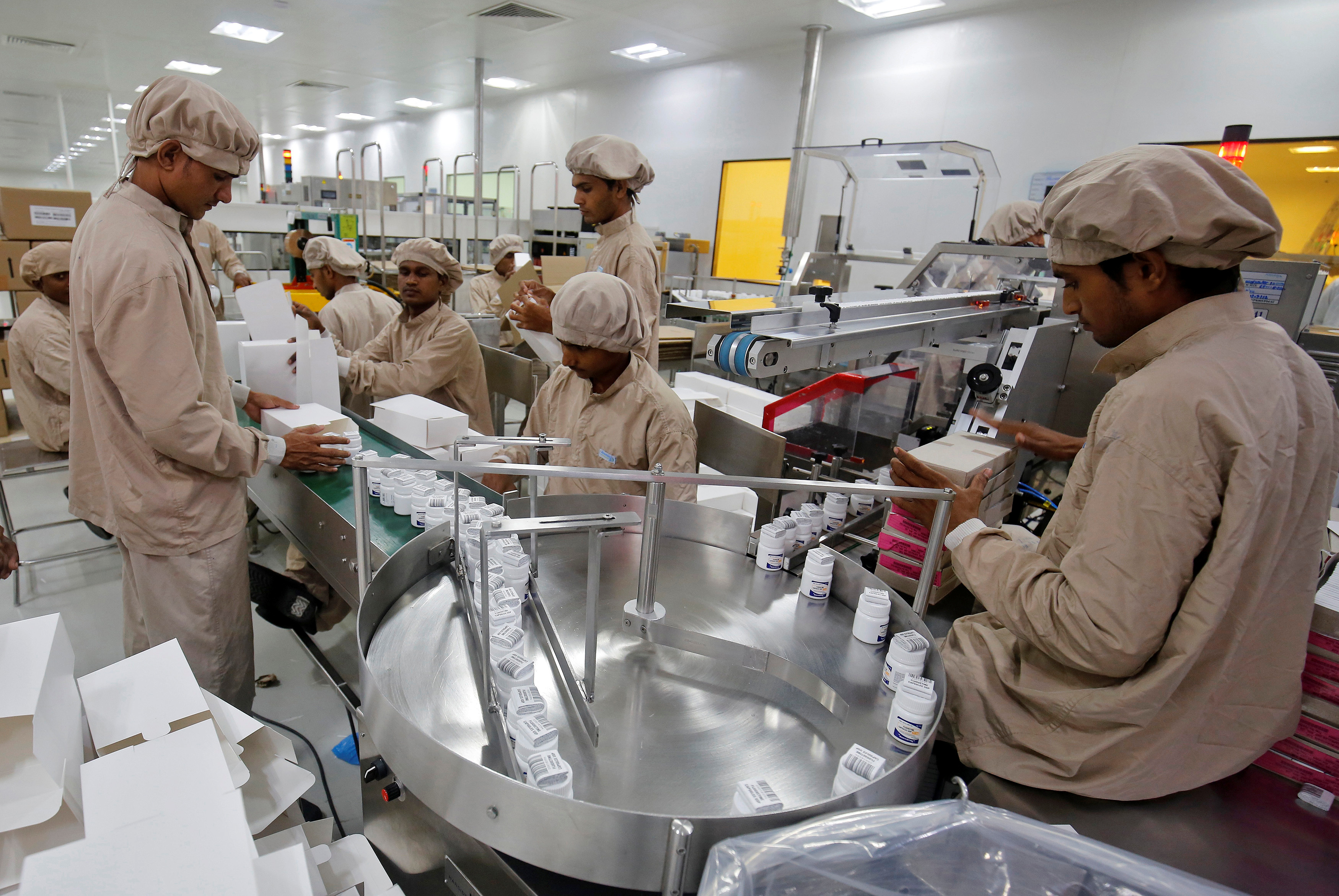 Workers pack medicine bottles inside Alembic Pharmaceutical Limited's plant in Halol, in the western state of Gujarat, India, July 14, 2017. REUTERS/Amit Dave