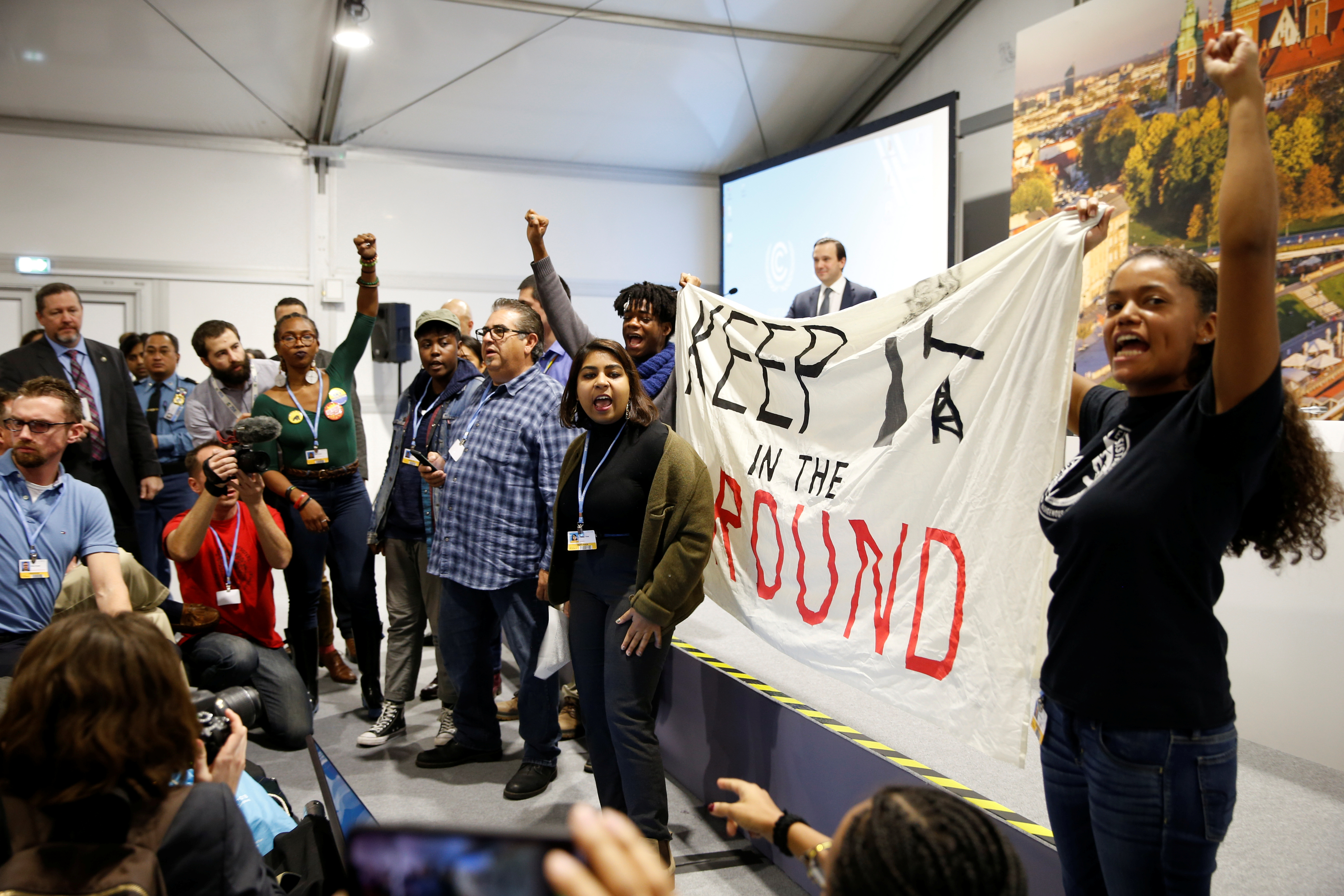 Environmental activists protest against fossil fuel during U.S. panel at the COP24 UN Climate Change Conference 2018 in Katowice