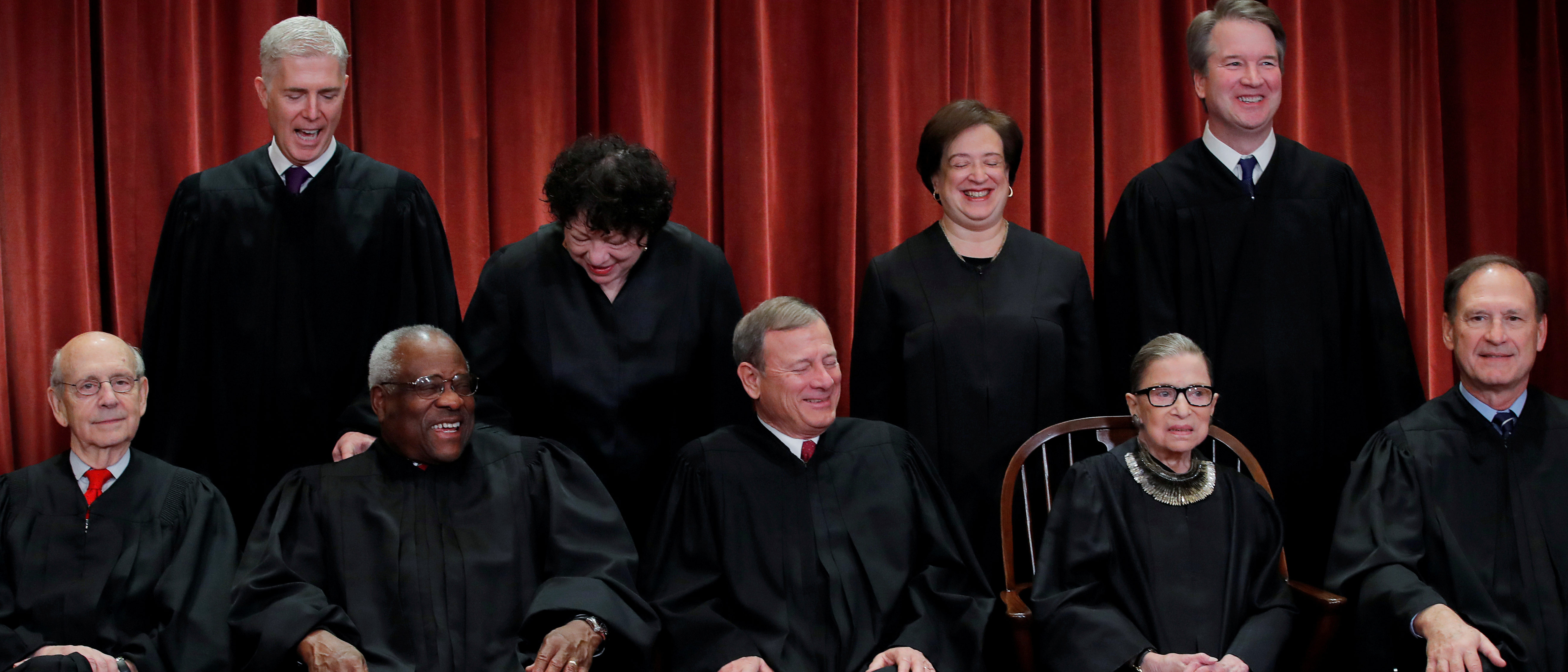 U.S. Supreme Court justices pose for their group portrait at the Supreme Court in Washington, U.S., November 30, 2018. Seated (L-R): Associate Justice Stephen Breyer, Associate Justice Clarence Thomas, Chief Justice of the United States John G. Roberts, Associate Justice Ruth Bader Ginsburg and Associate Justice Samuel Alito, Jr. Standing behind (L-R): Associate Justice Neil Gorsuch, Associate Justice Sonia Sotomayor, Associate Justice Elena Kagan and Associate Justice Brett M. Kavanaugh. REUTERS/Jim Young.