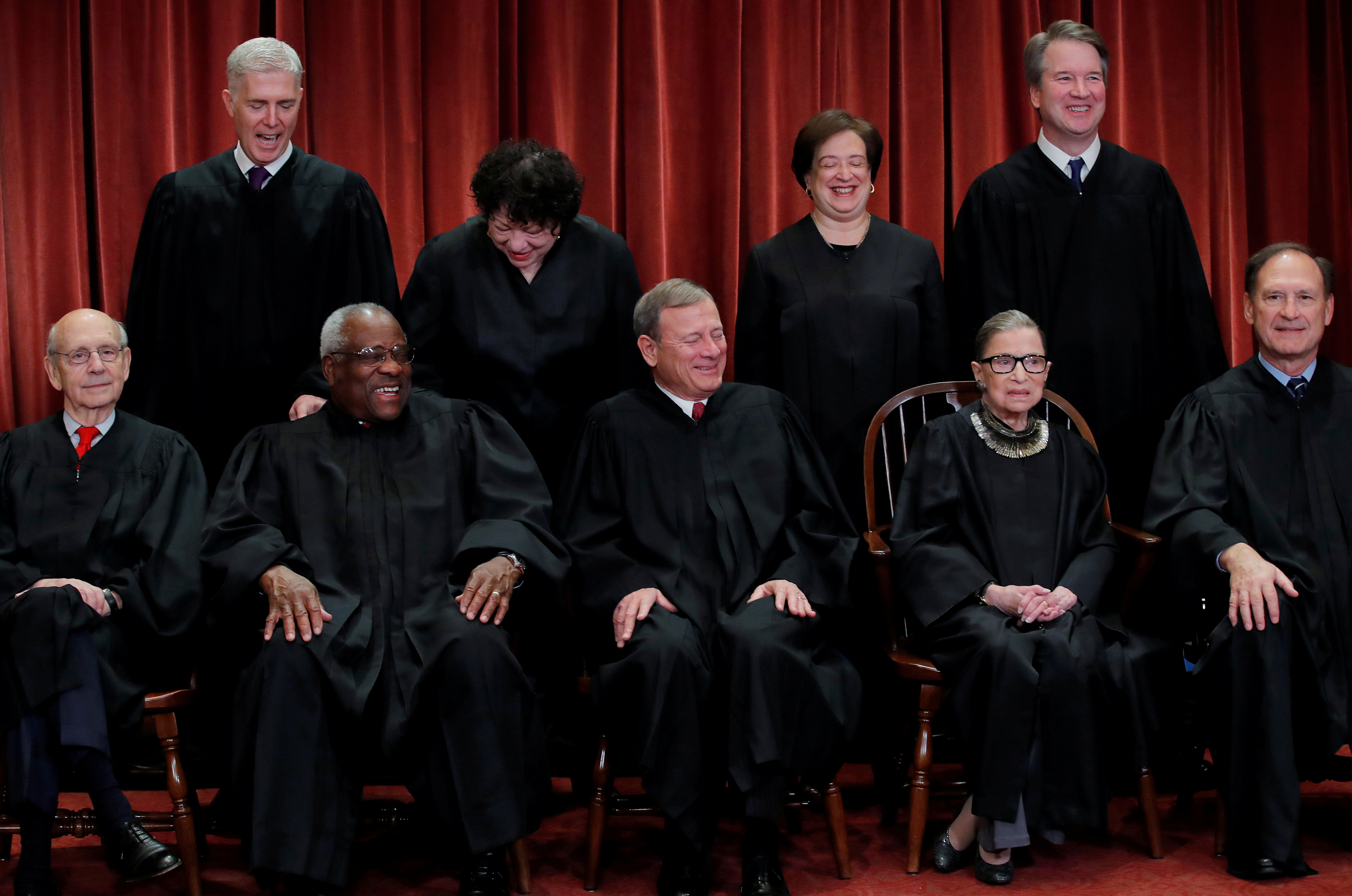 U.S. Supreme Court justices pose for group portrait at the Supreme Court in Washington