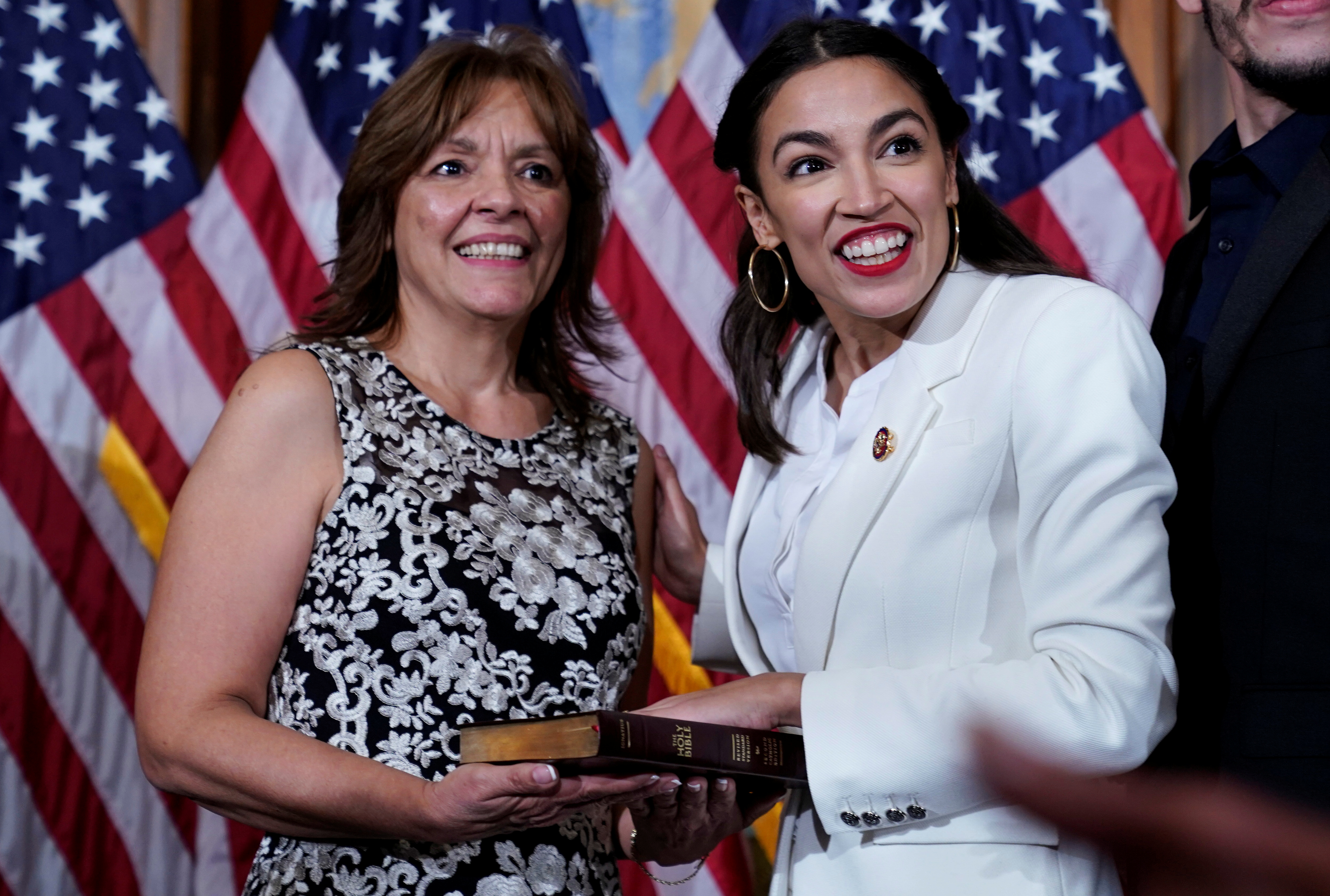 Rep. Alexandria Ocasio-Cortez (D-NY) stands with her mother Blanca Ocasio-Cortez before a ceremonial swearing-in picture on Capitol Hill in Washington