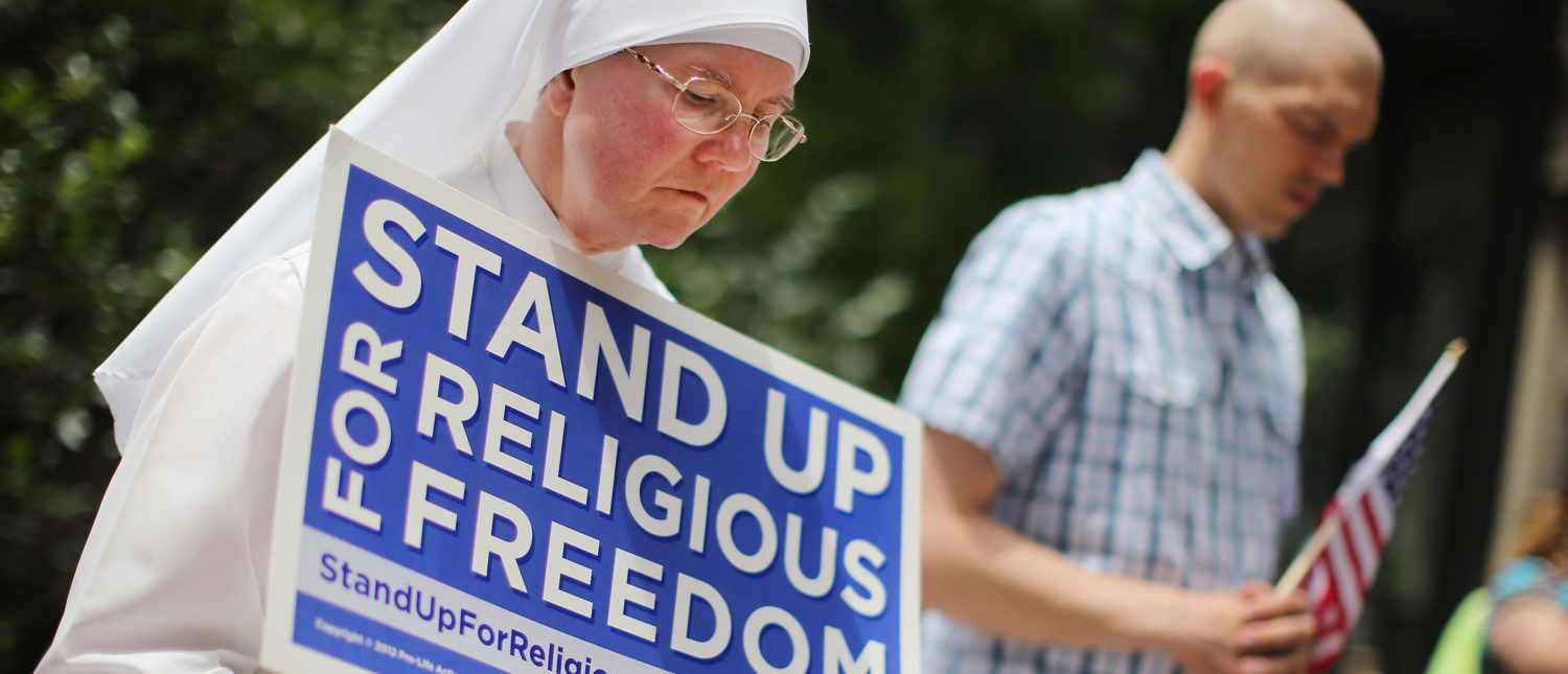 Sister Caroline attends a rally with other supporters of religious freedom to praise the Supreme Court's decision in the Hobby Lobby case. (Scott Olson/Getty Images)