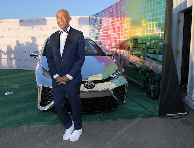 Russell Simmons poses with the Toyora Mirai, the zero emissions car, during the 2017 EMA Awards Presented by Toyota on September 23, 2017 in Santa Monica, California. (Photo by Charley Gallay/Getty Images for Toyota Mirai)