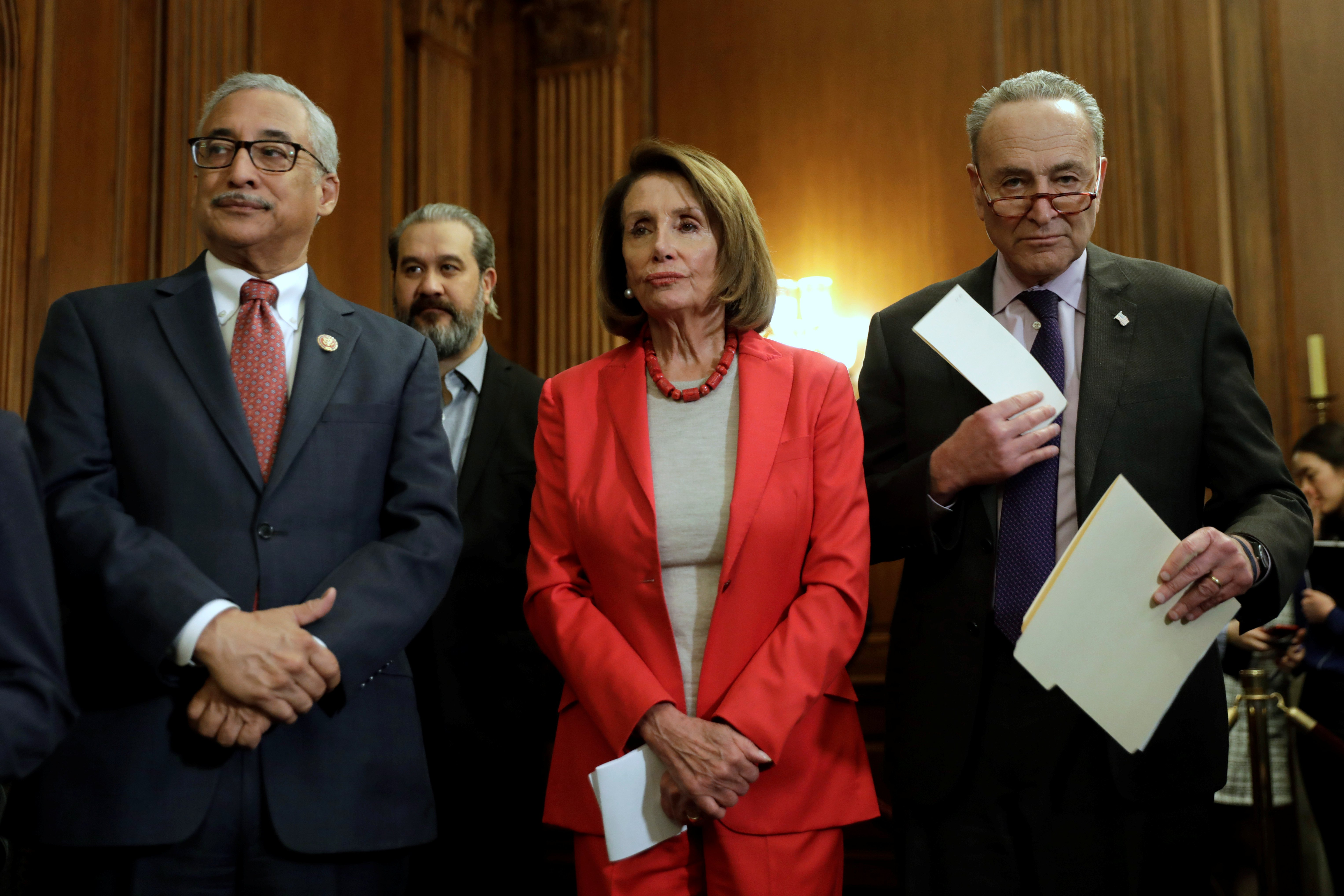 "U.S. House Speaker Nancy Pelosi (D-CA) with Senate Minority Leader Chuck Schumer (D-NY) (R) and Representative Bobby Scott (D-VA) wait to speak during a news conference on ""Raise the Wage Act"" legislation on Capitol in Washington, U.S., January 16, 2019. REUTERS/Yuri Gripas"