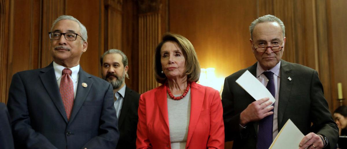 "U.S. House Speaker Nancy Pelosi (D-CA) with Senate Minority Leader Chuck Schumer (D-NY) (R) and Representative Bobby Scott (D-VA) wait to speak during a news conference on ""Raise the Wage Act"" legislation on Capitol in Washington, U.S., January 16, 2019. REUTERS/Yuri Gripas"