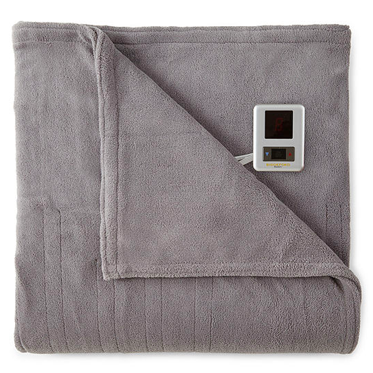 Normally $100, this heated blanket is 60 percent off with the code (Photo via JC Penney)
