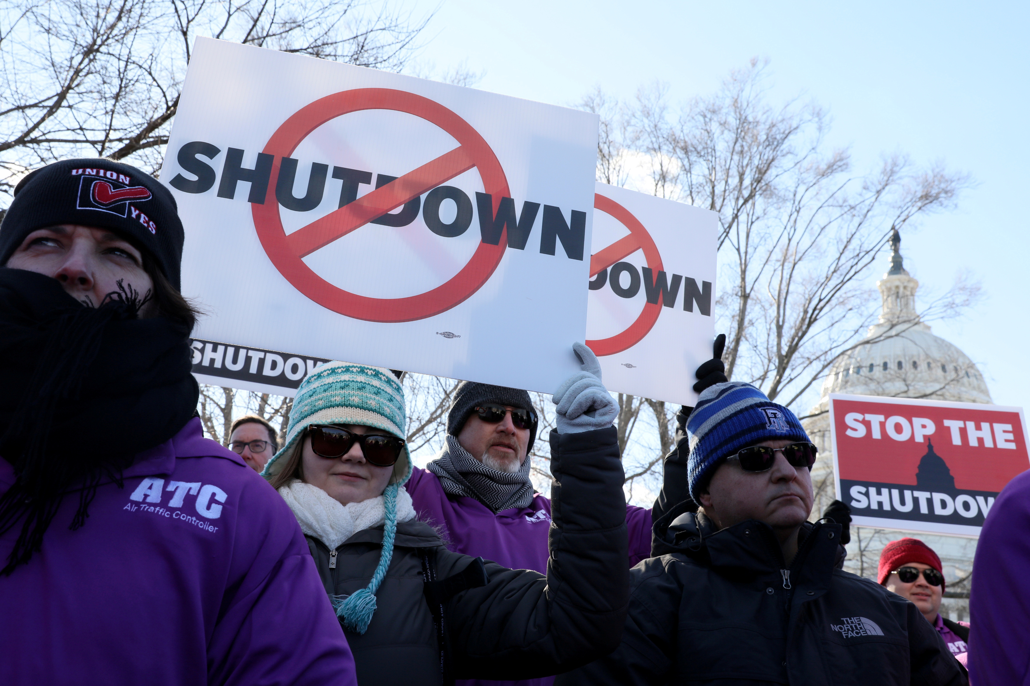 Federal air traffic controller union members protest the partial U.S. federal government shutdown in a rally at the U.S. Capitol in Washington, U.S. Jan. 10, 2019. REUTERS/Jonathan Ernst