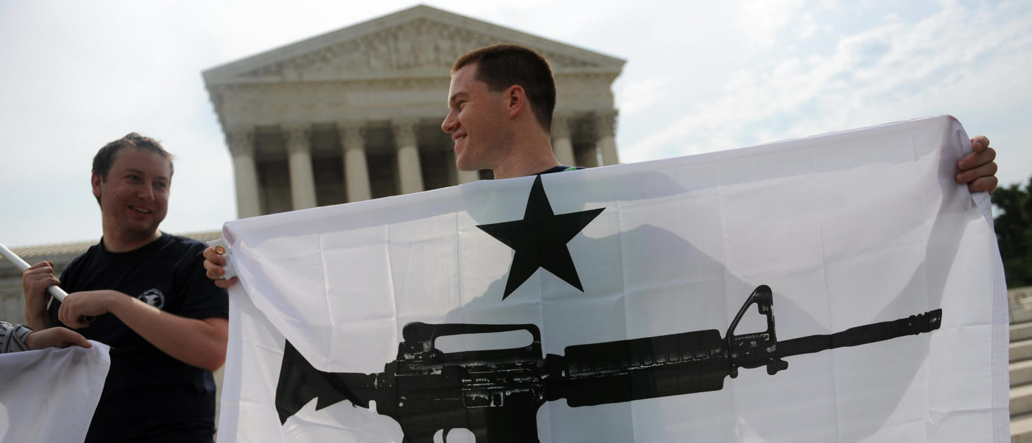 Gun rights activists celebrate the news from the Supreme Court that Americans have a constitutional right to bear arms on June 26, 2008 (Tim Sloan/AFP/Getty Images)