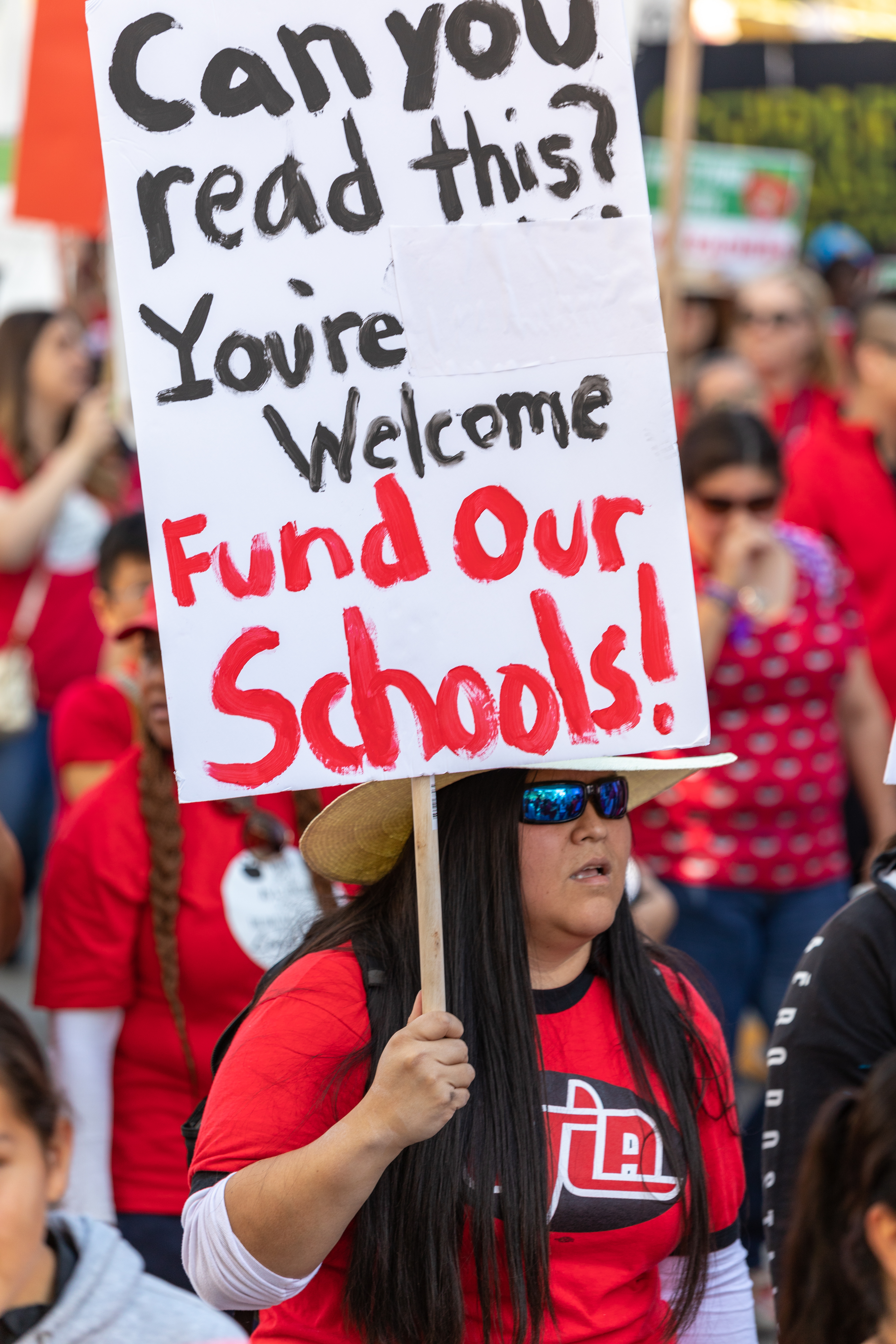 Pictured is a teacher protesting for more school funding. SHUTTERSTOCK/ Karl_Sonnenberg