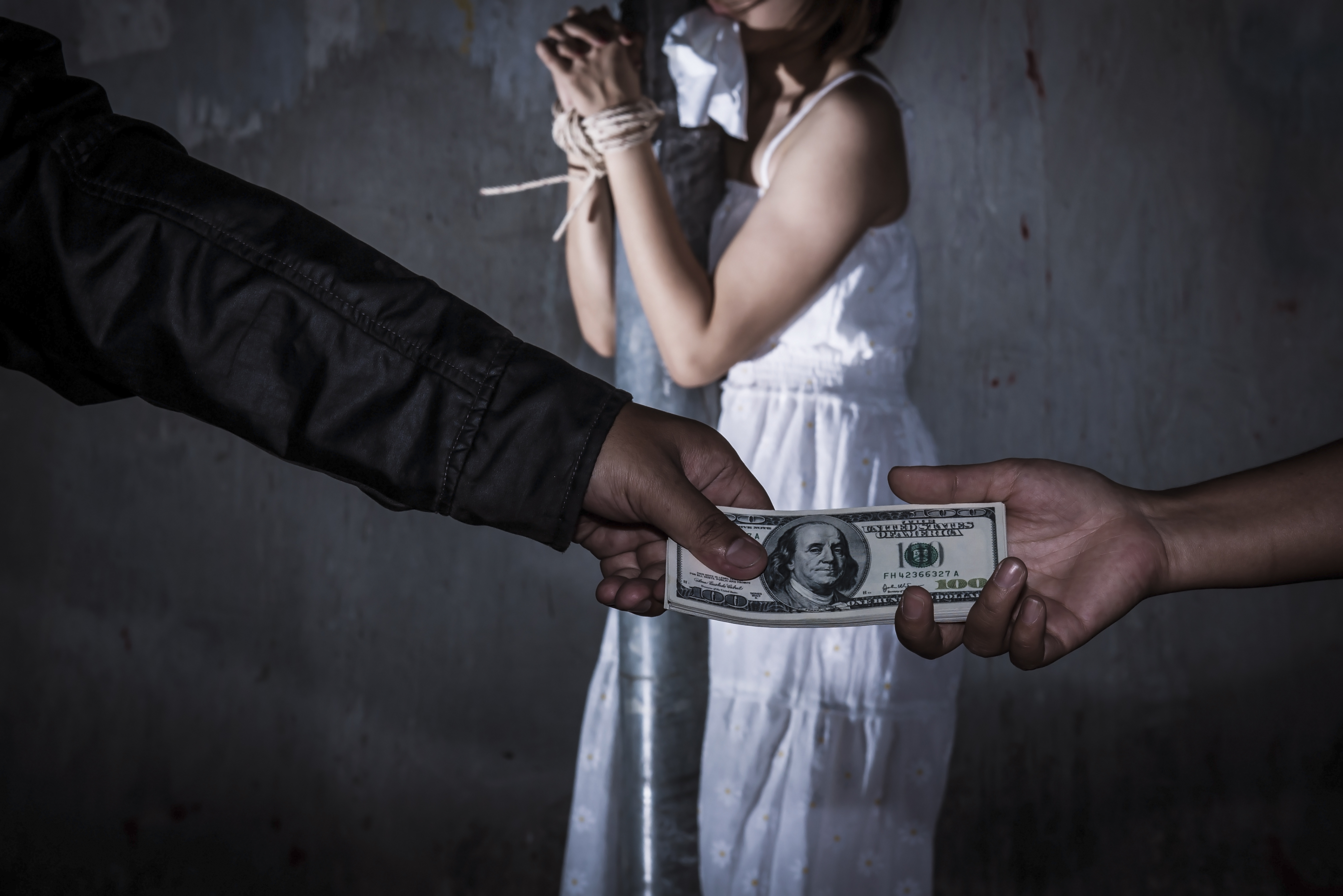 Pictured is a concept of human trafficking. SHUTTERSTOCK/ Pitiya Phinjongsakundit