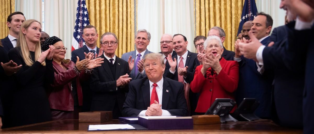 President Trump is applauded after signing the First Step Act Dec. 21, 2018. Jim WATSON/AFP/Getty Images.